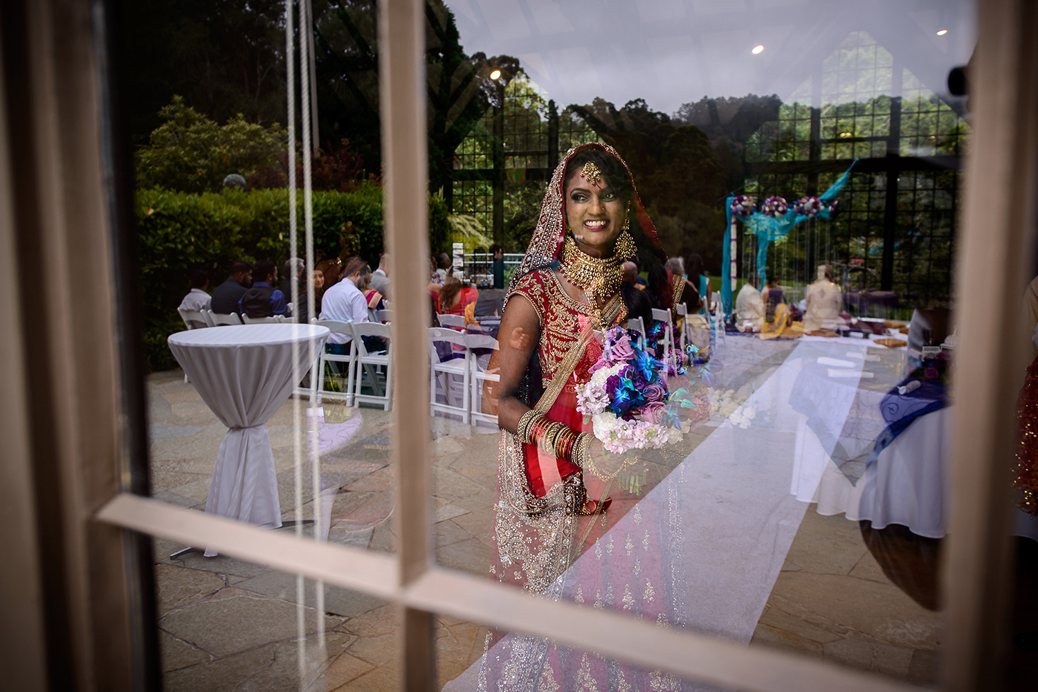 indian bride looking at the ceremony during ganesh pooja at Brazilian Room - Tilden Regional Park, Berkeley