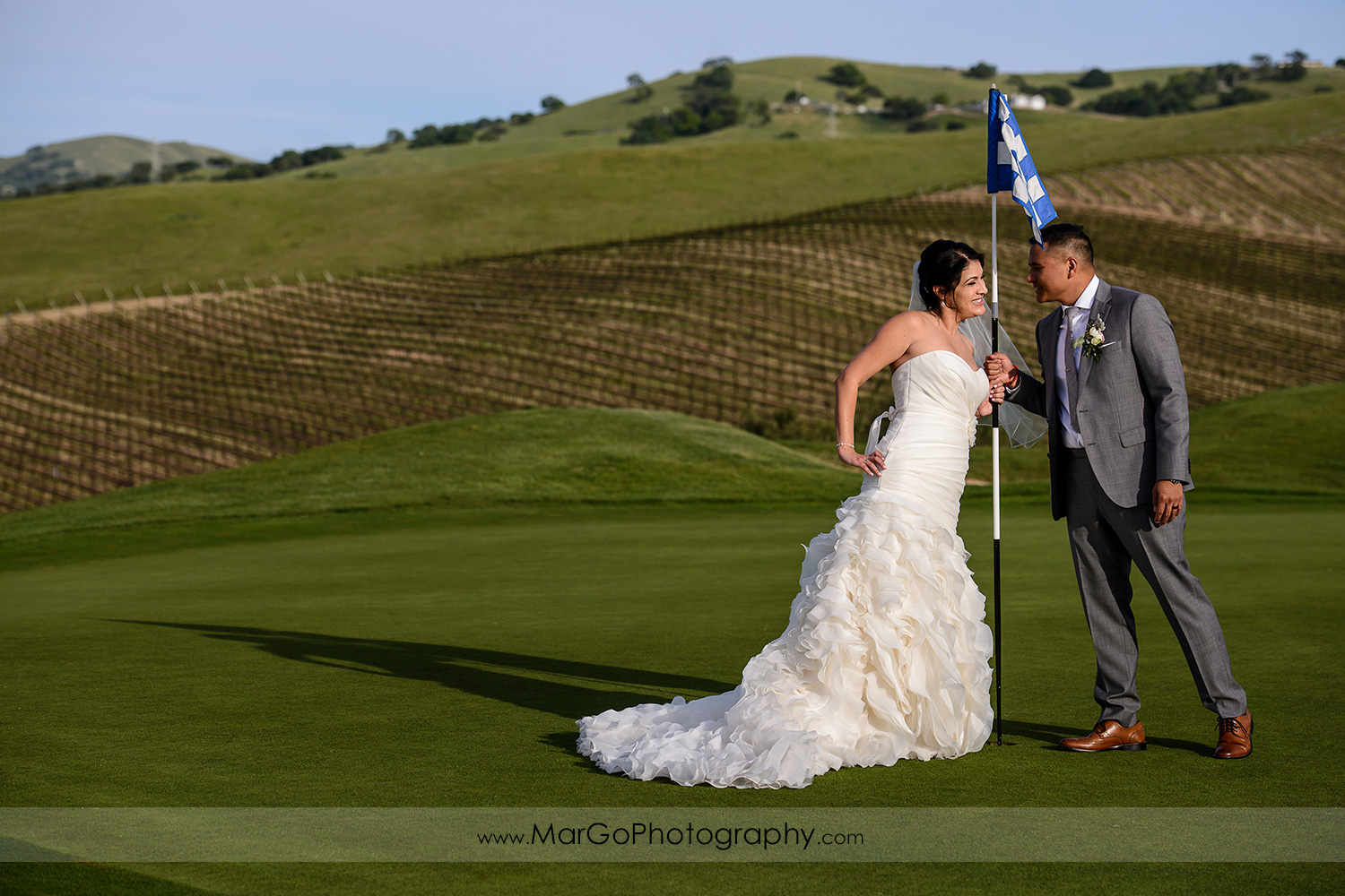 bride and groom on the hill at Poppy Ridge Golf Course in Livermore