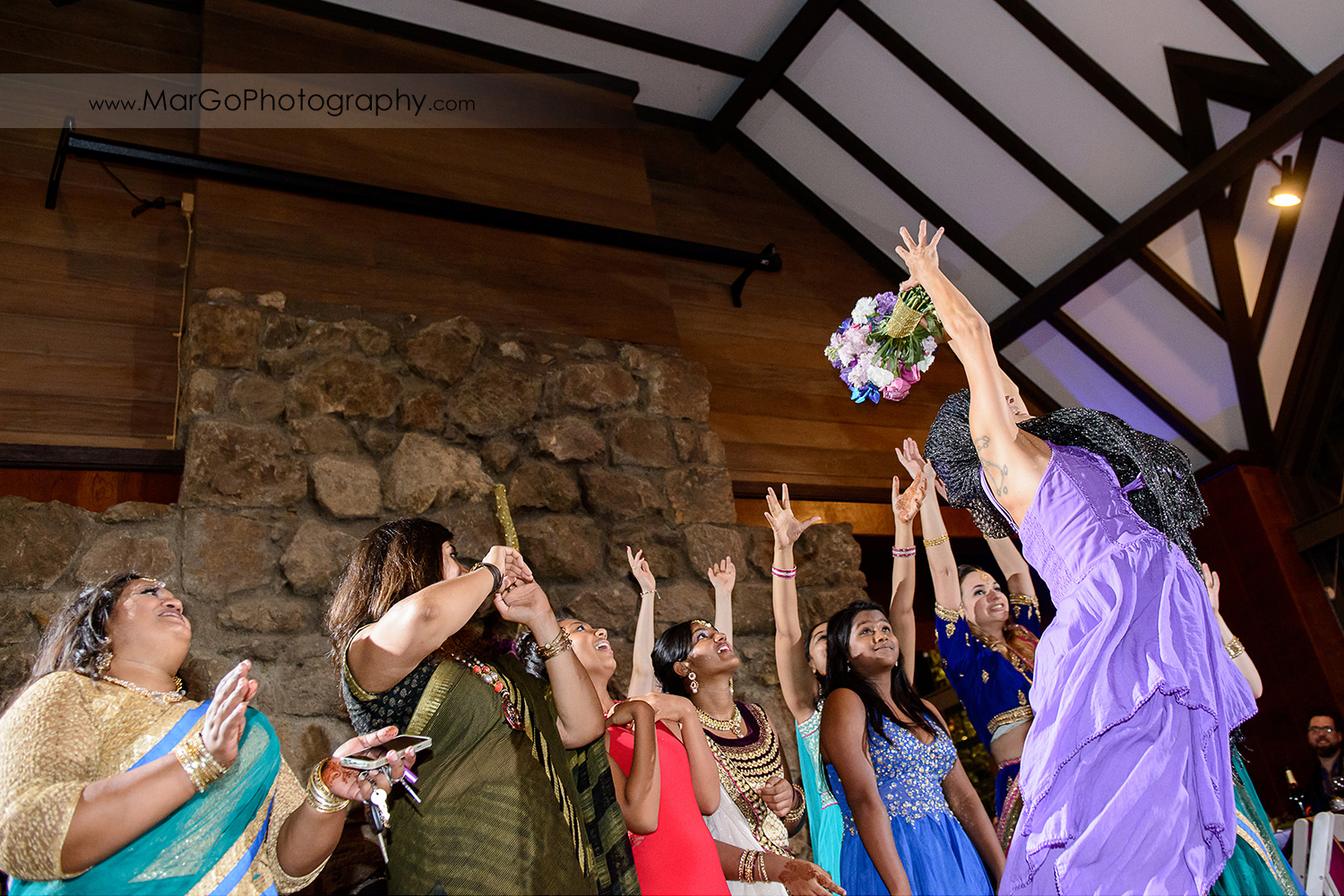 bouquet toss at indian wedding at Brazilian Room - Tilden Regional Park, Berkeley