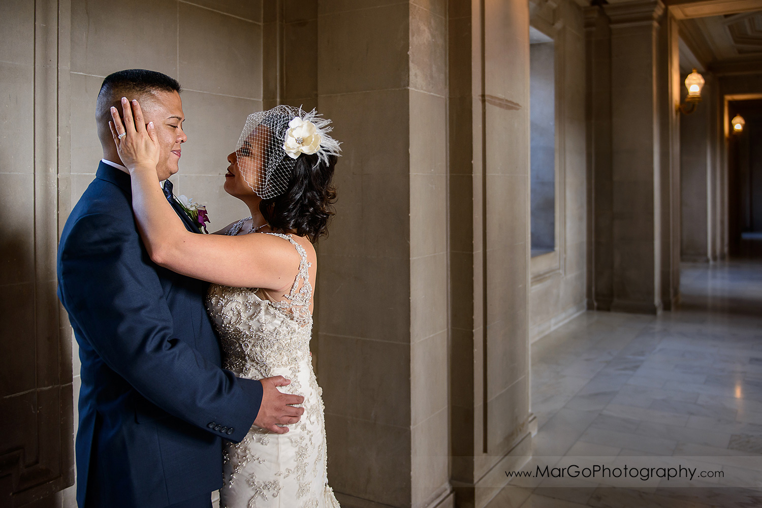 bride and groom looking at each other at San Francisco City Hall