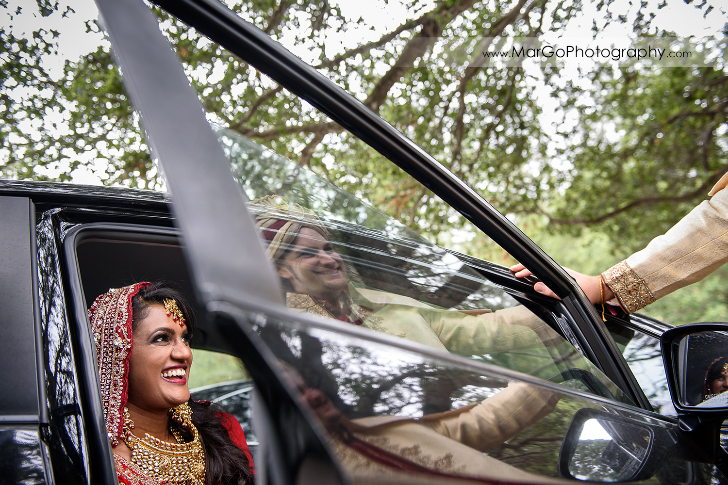 indian bride and groom reflection in the car window at Brazilian Room - Tilden Regional Park, Berkeley