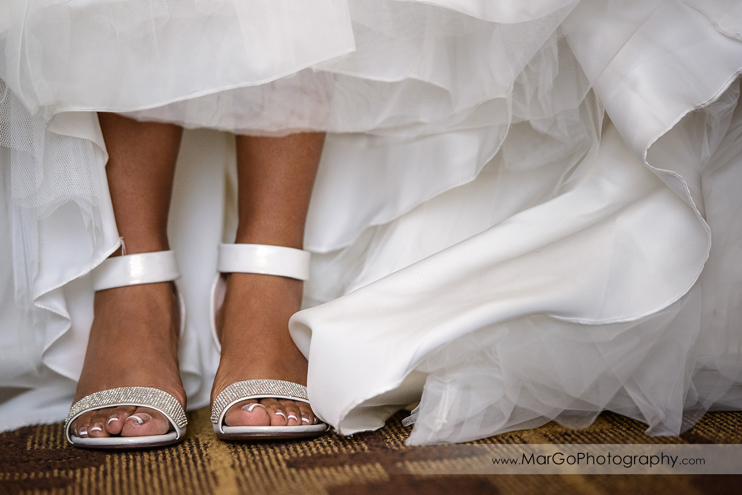 bride showing wedding shoes at Best Western Plus Delta Inn & Suites in Oakley