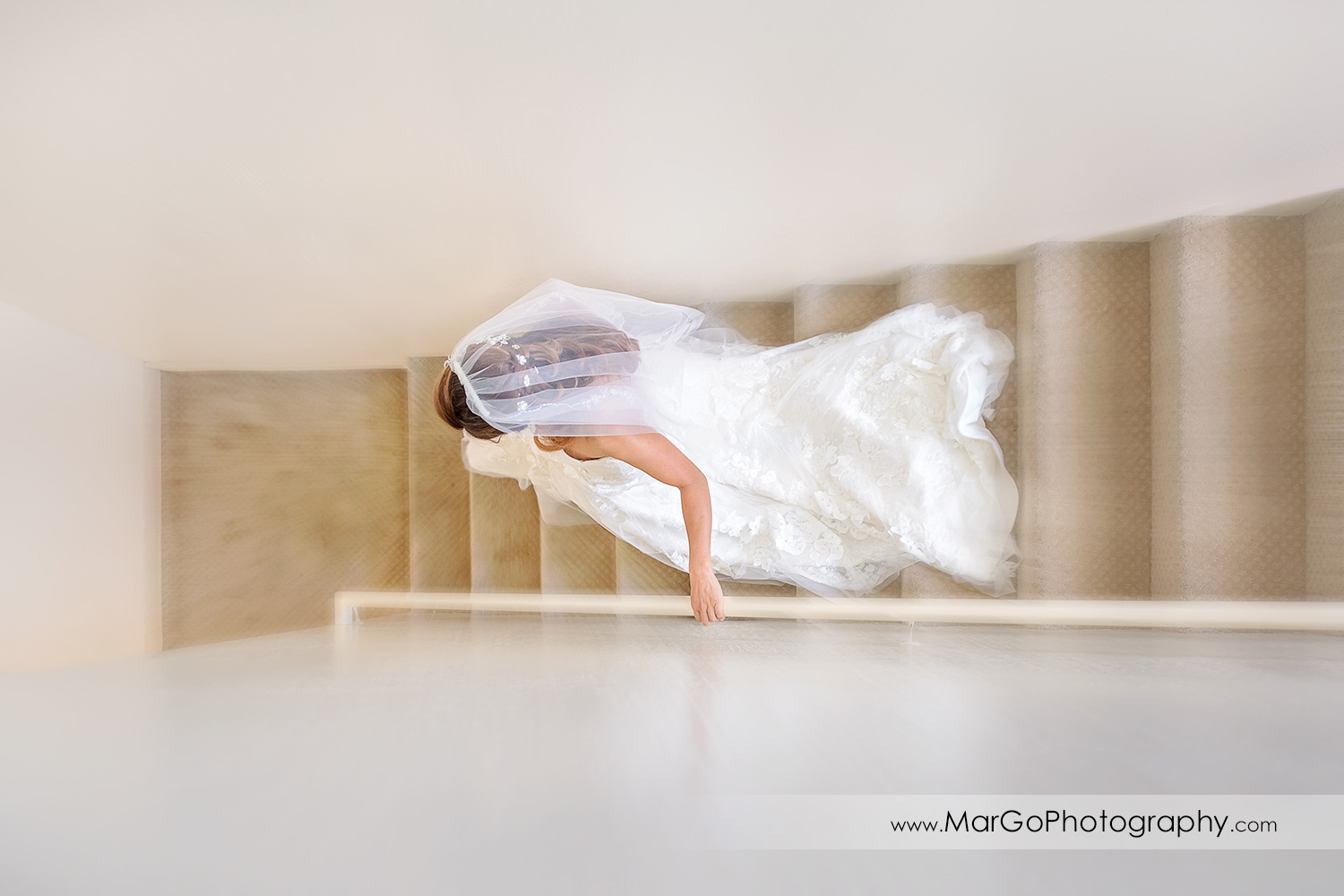 bride walking down the stairs at Mavericks Event Center in Half Moon Bay