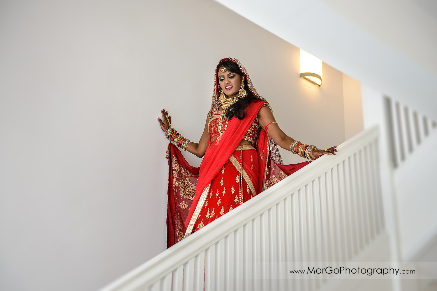 indian bride wlaking down the stairs at Hotel Shattuck Plaza in Berkeley