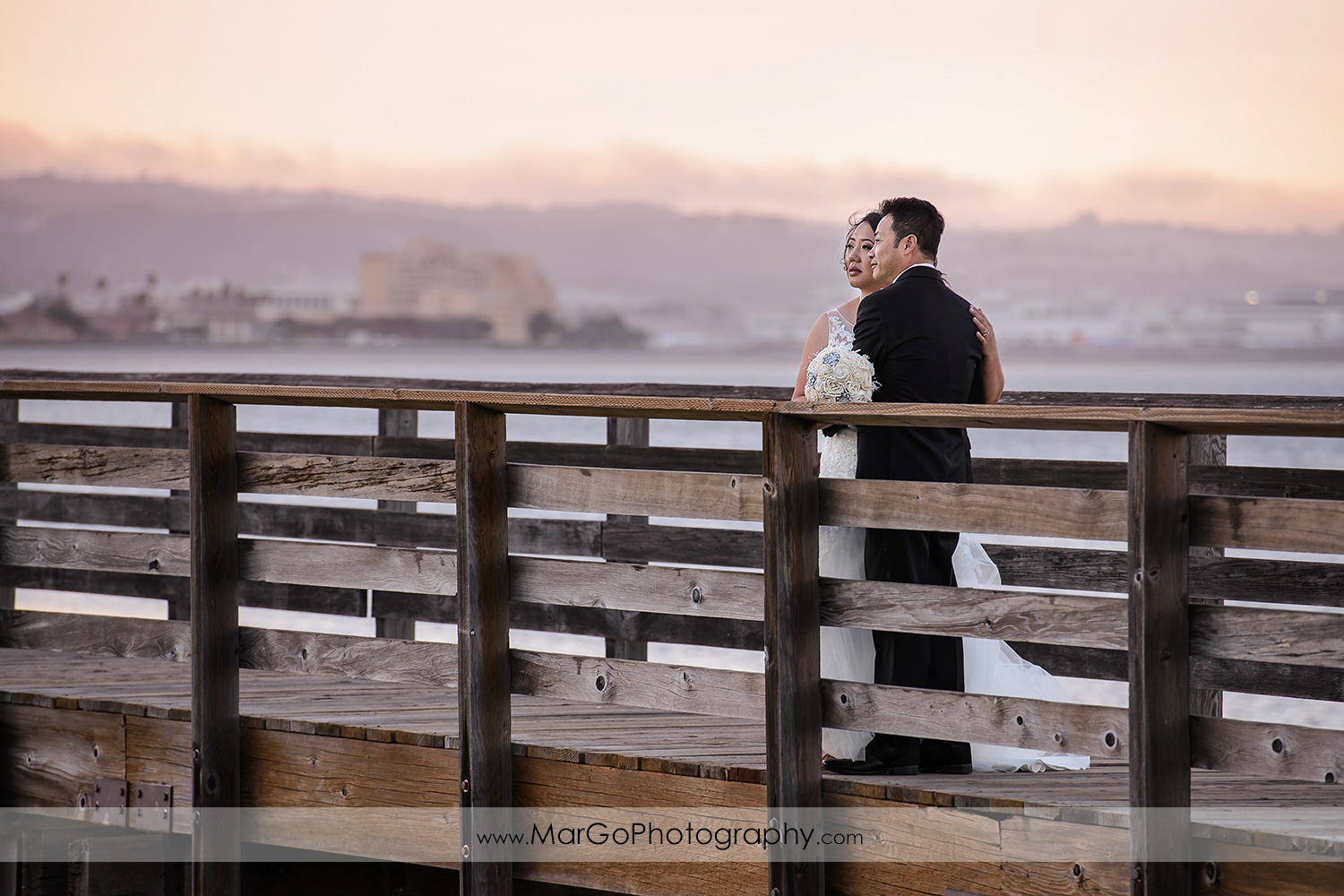sunset photo of bride and groom on the bridge at Robert Woolley State Park in Burlingame