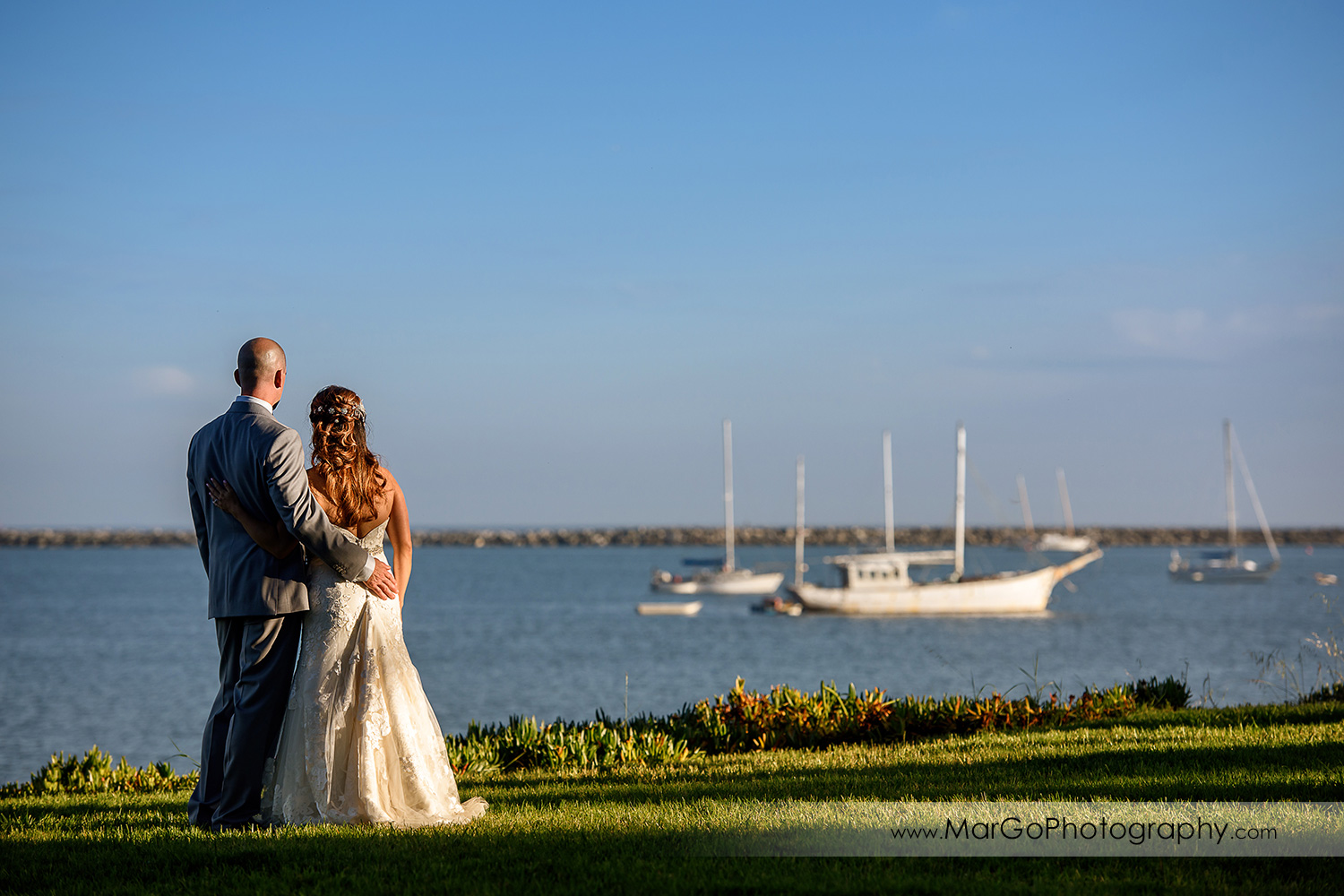 bride and groom looking at Half Moon Bay from Mavericks Event Center
