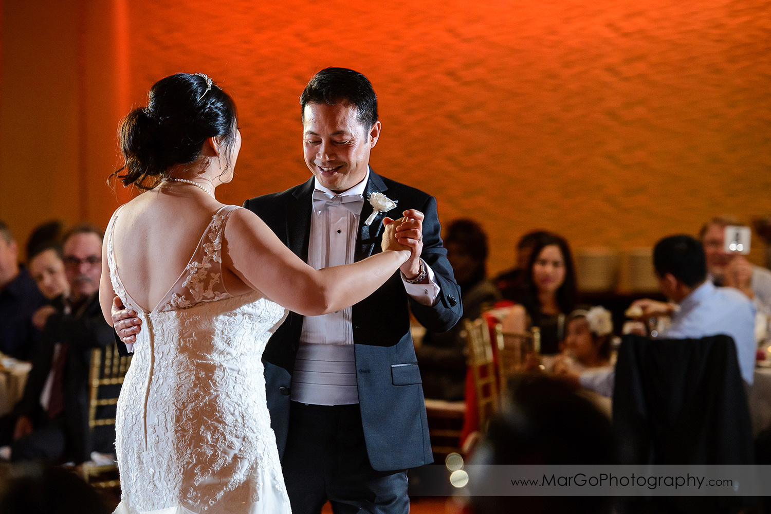 groom during first dance at Hilton San Francisco Airport Bayfront in Burlingame