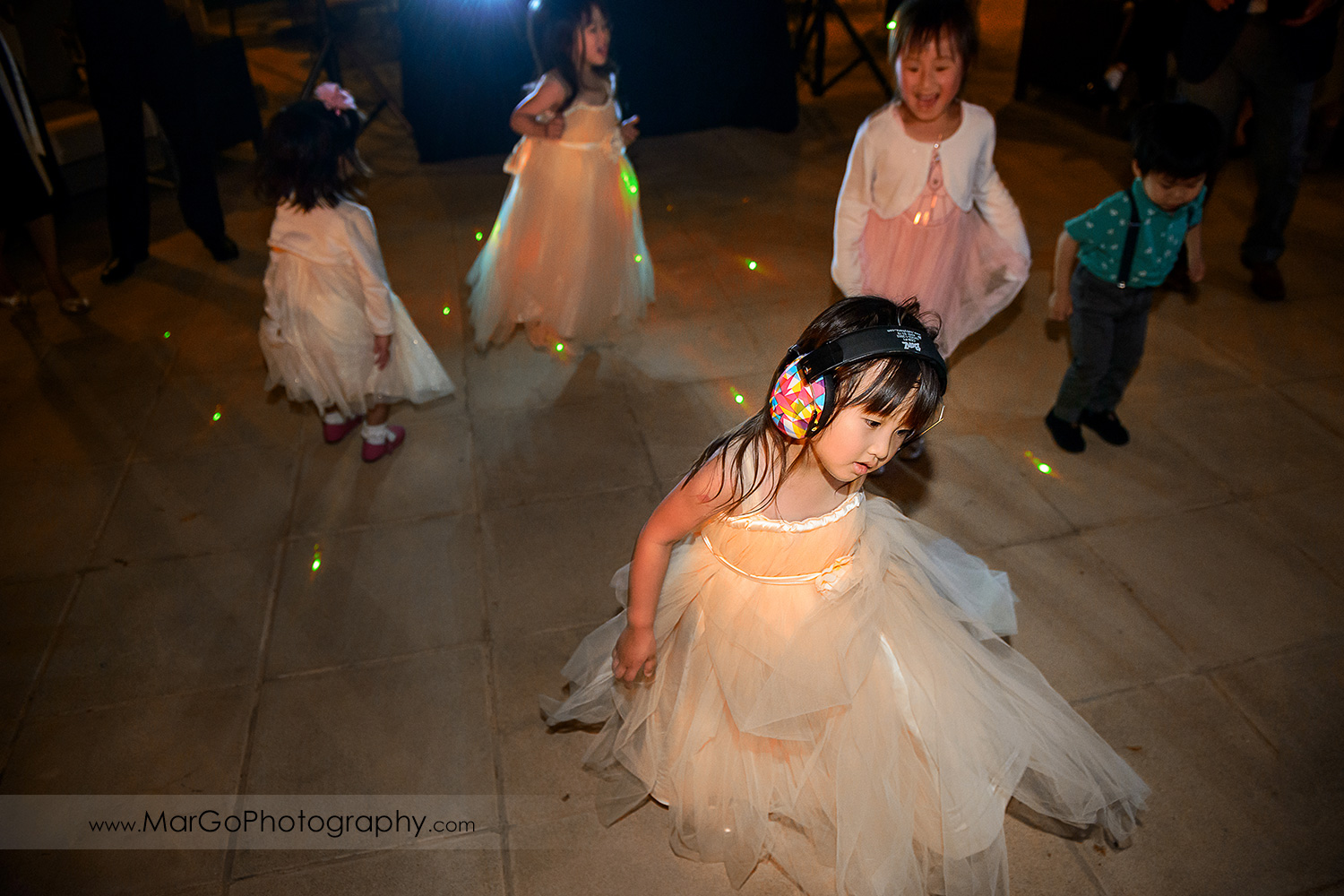 flower girl dancing during wedding reception at the Club at Ruby Hill in Pleasanton