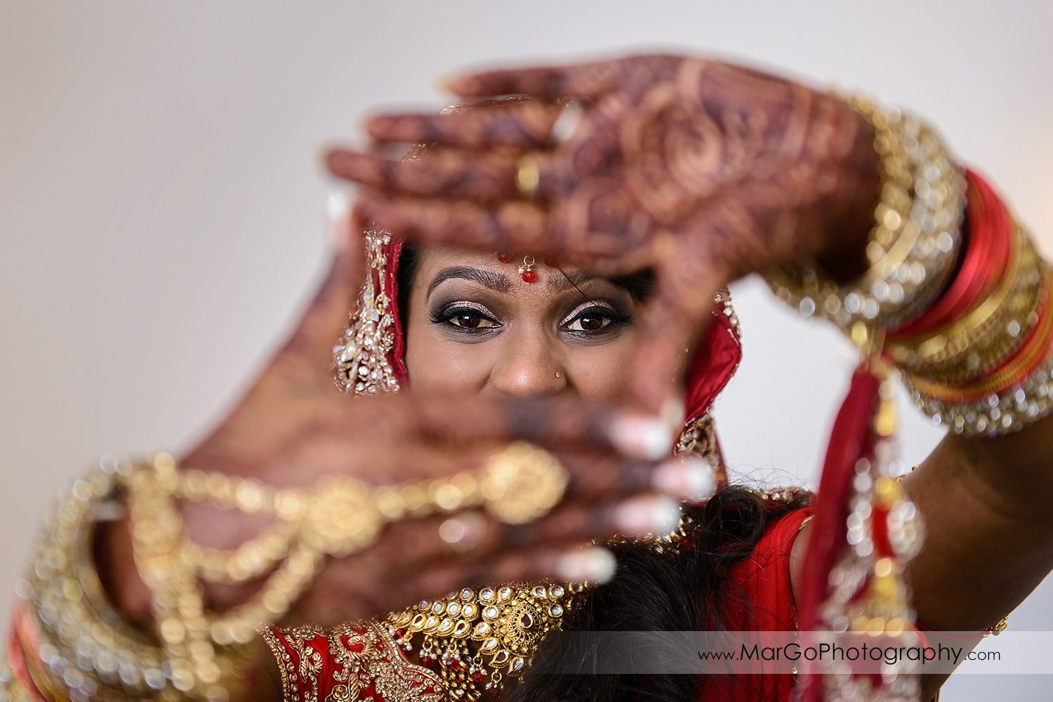 indian bride through the henna hands at Hotel Shattuck Plaza in Berkeley