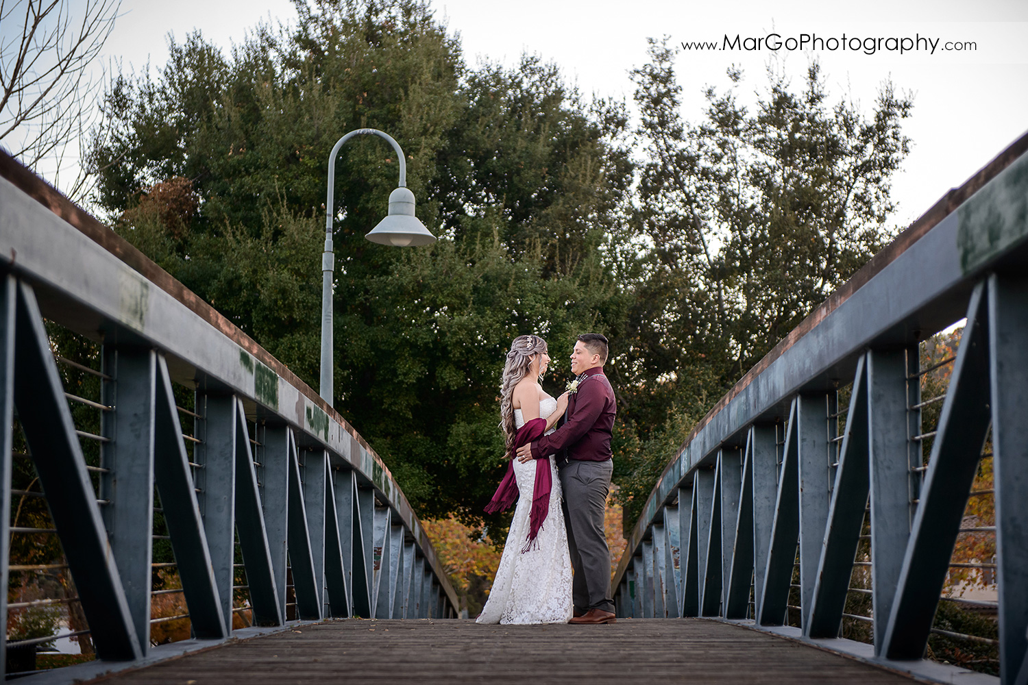 bride and groom on the bridge in Martinez