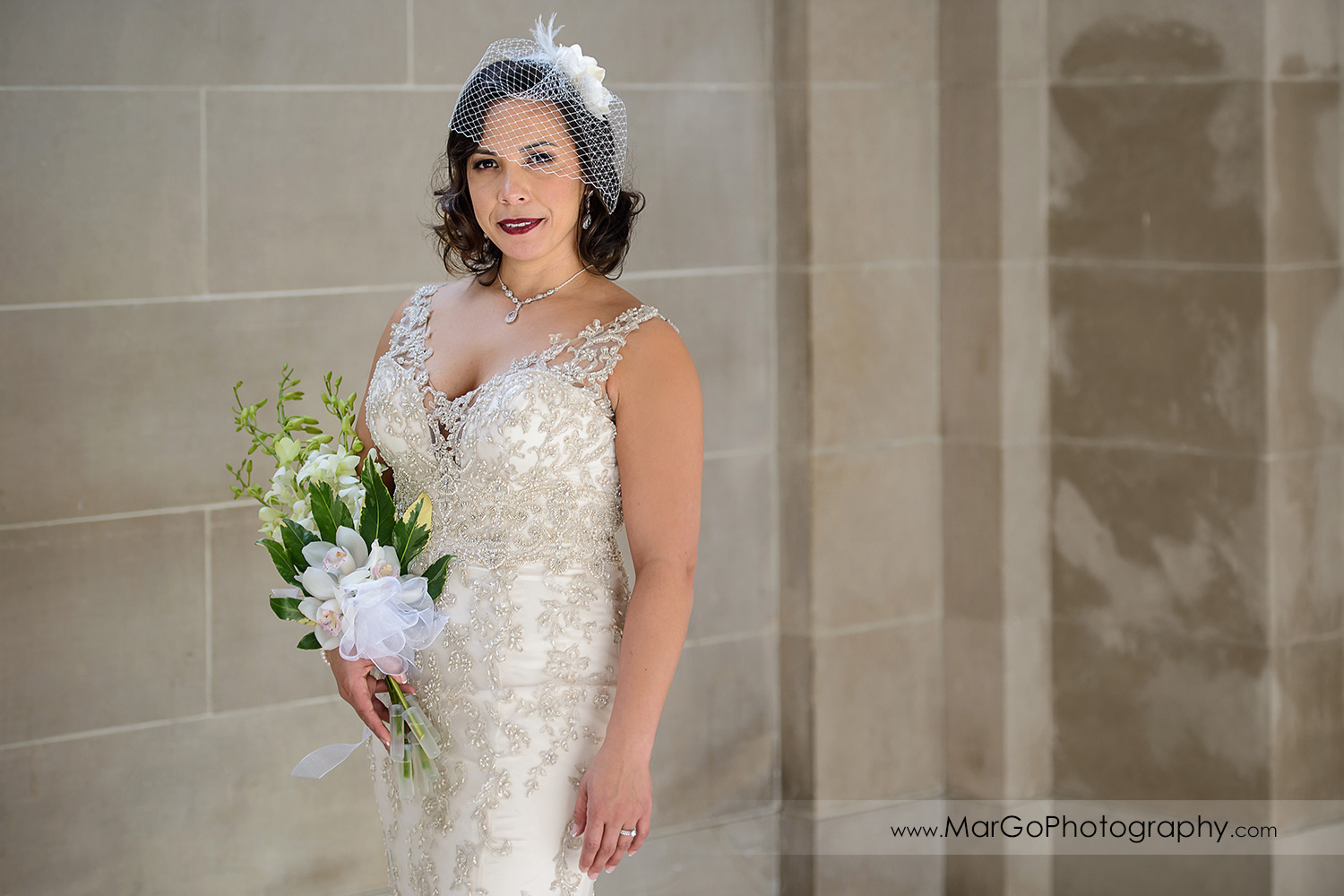 portrait of the bride with the bouquet at San Francisco City Hall