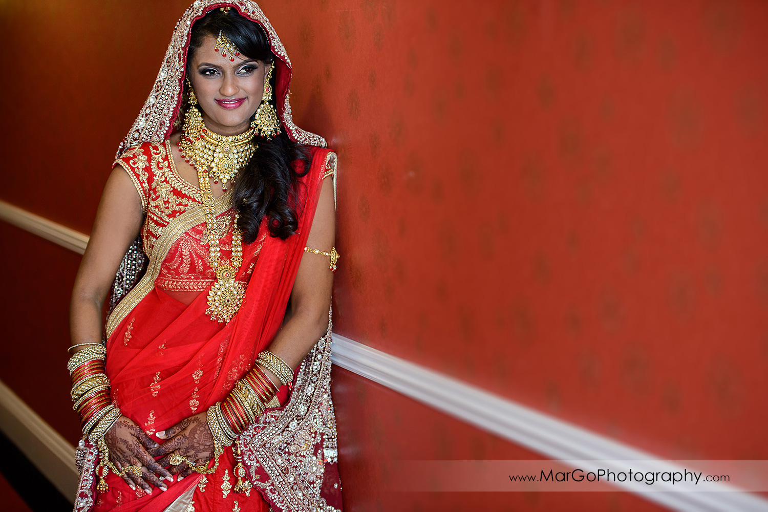 portrait of the indian bride on the red wall at Hotel Shattuck Plaza in Berkeley