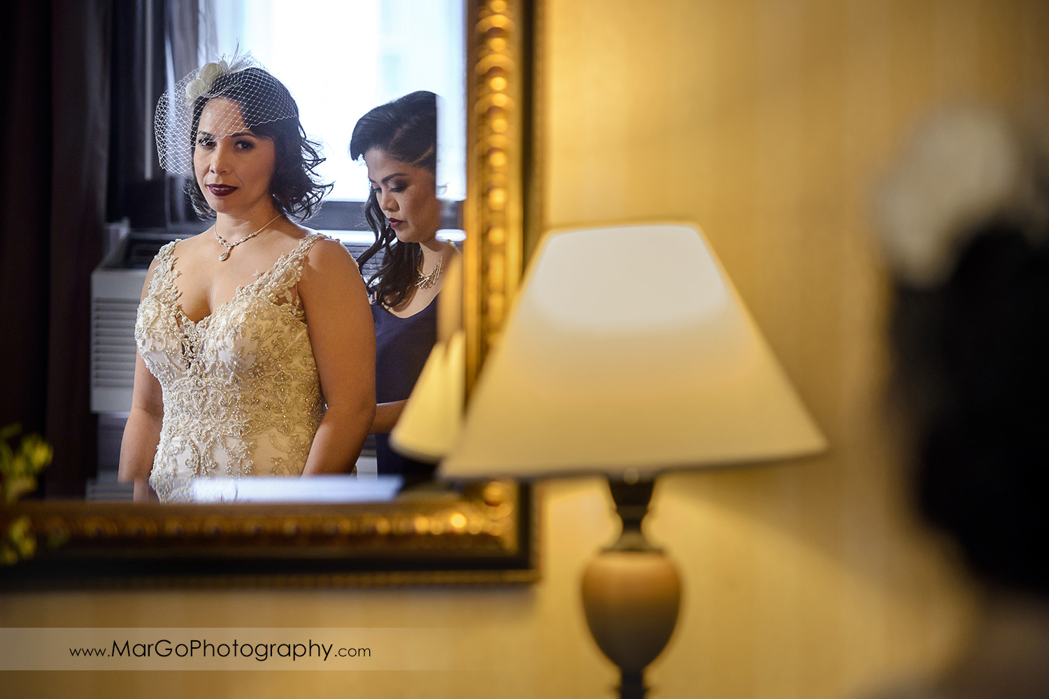 reflection of the bride getting ready at Whitcomb Hotel in San Francisco