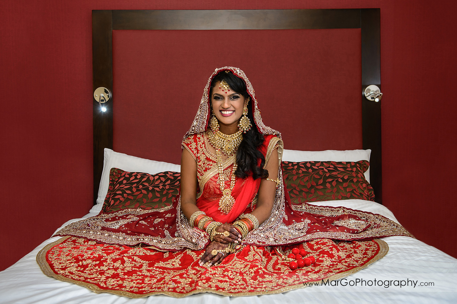 portrait of the indian bride sitting on the bed at Hotel Shattuck Plaza in Berkeley