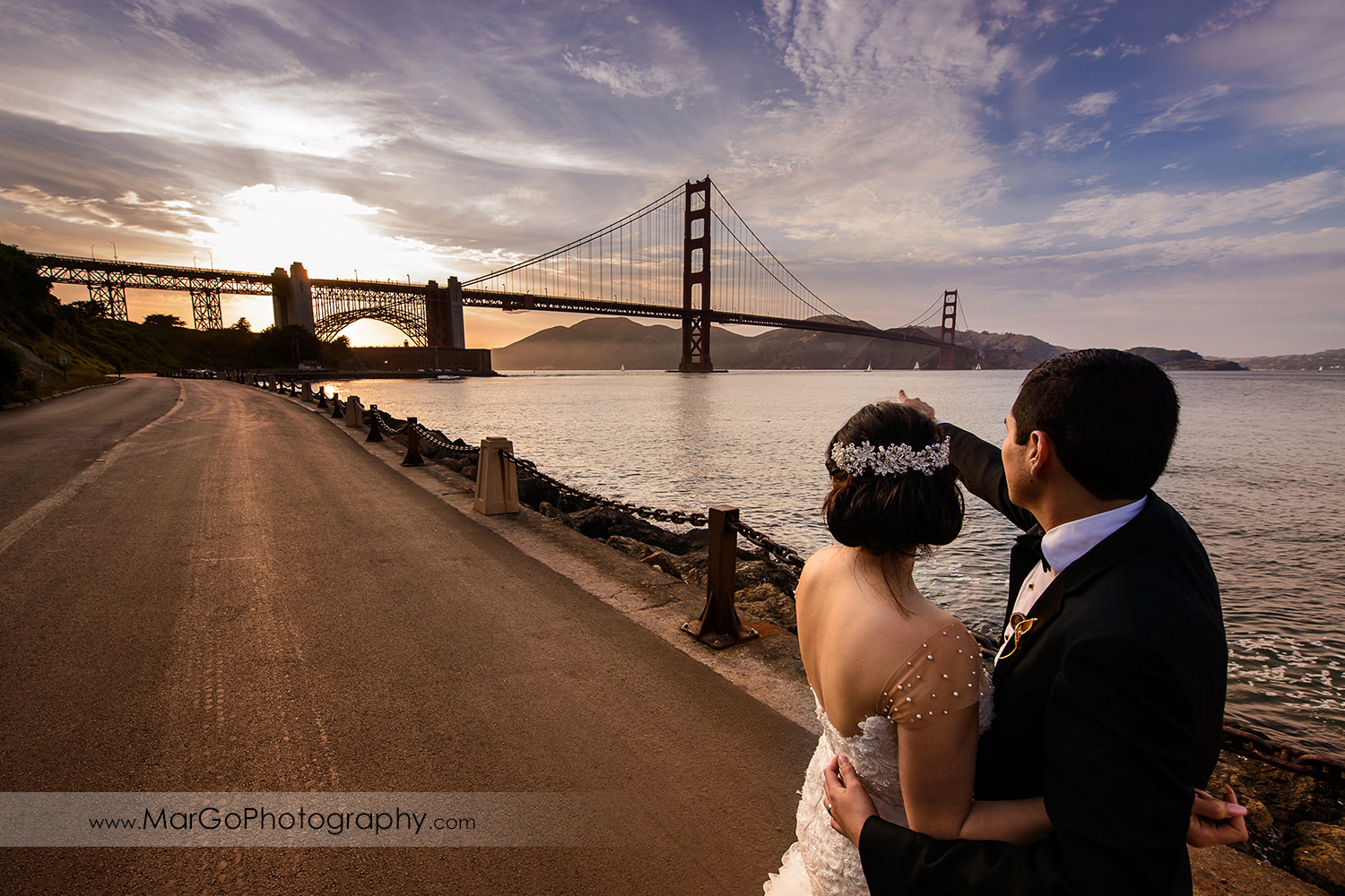 bride and groom looking at San Francisco Golden Gate Bridge