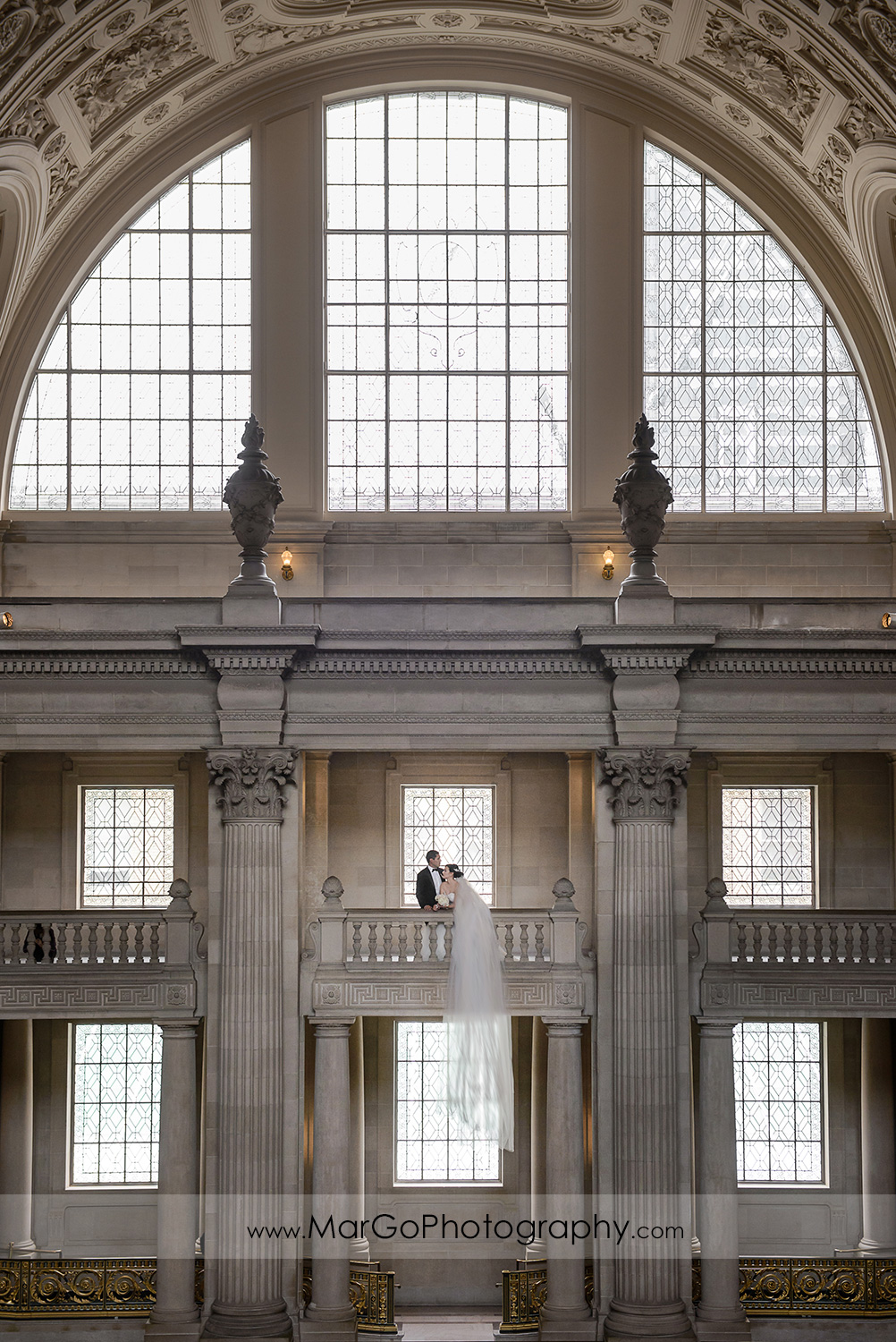 bride and groom on the third floor of San Francisco City Hall