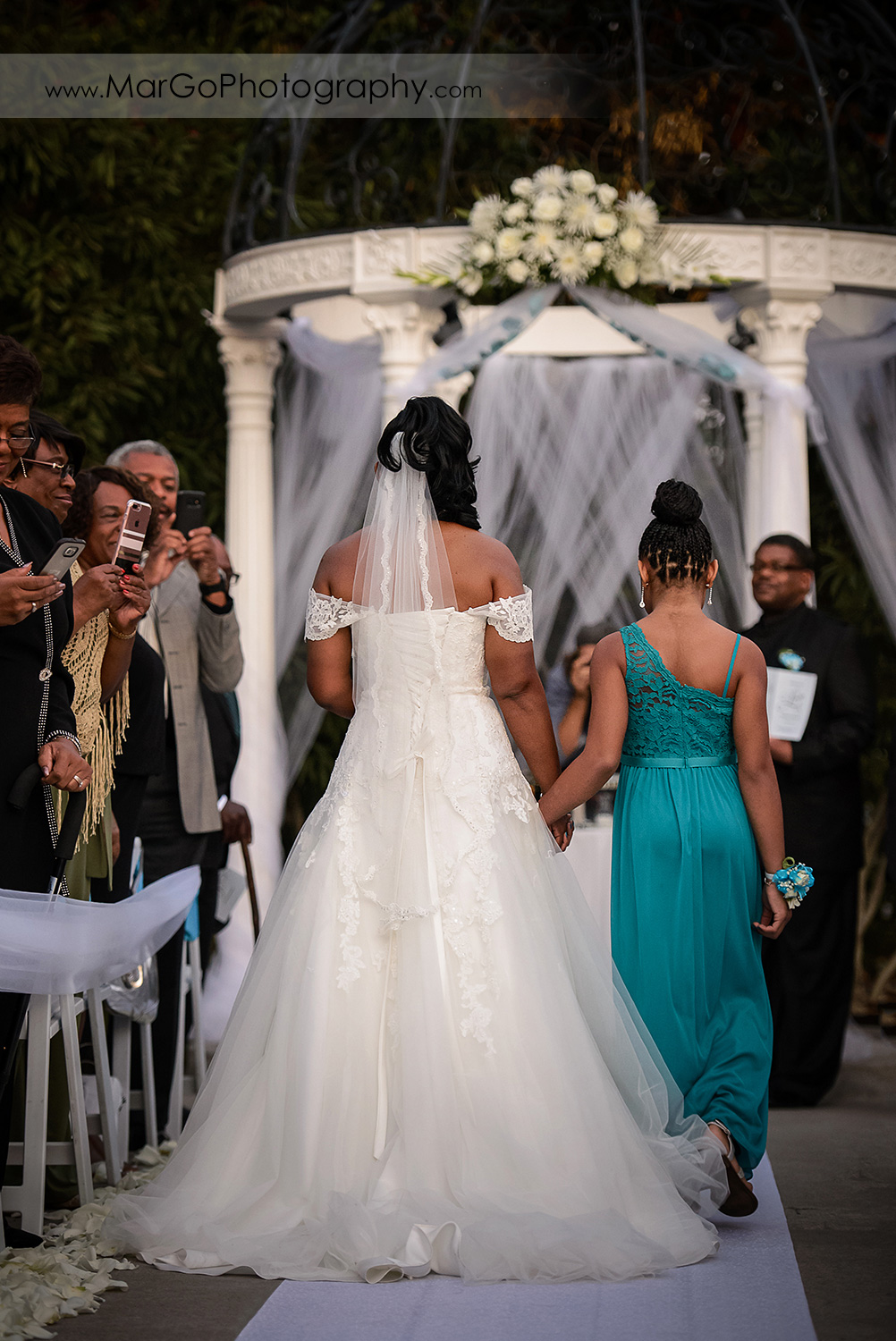 bride walking down the aisle at Wedgewood Wedding & Banquet Center in Brentwood