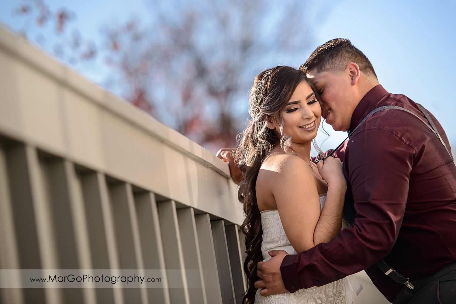 bride and groom leaning on the wall at Pleasant Hill City Hall