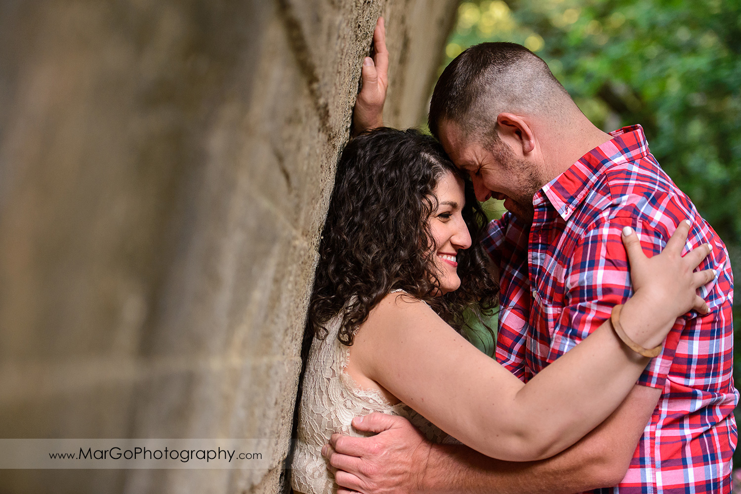 engaged couple under the bridge at Saratoga Springs
