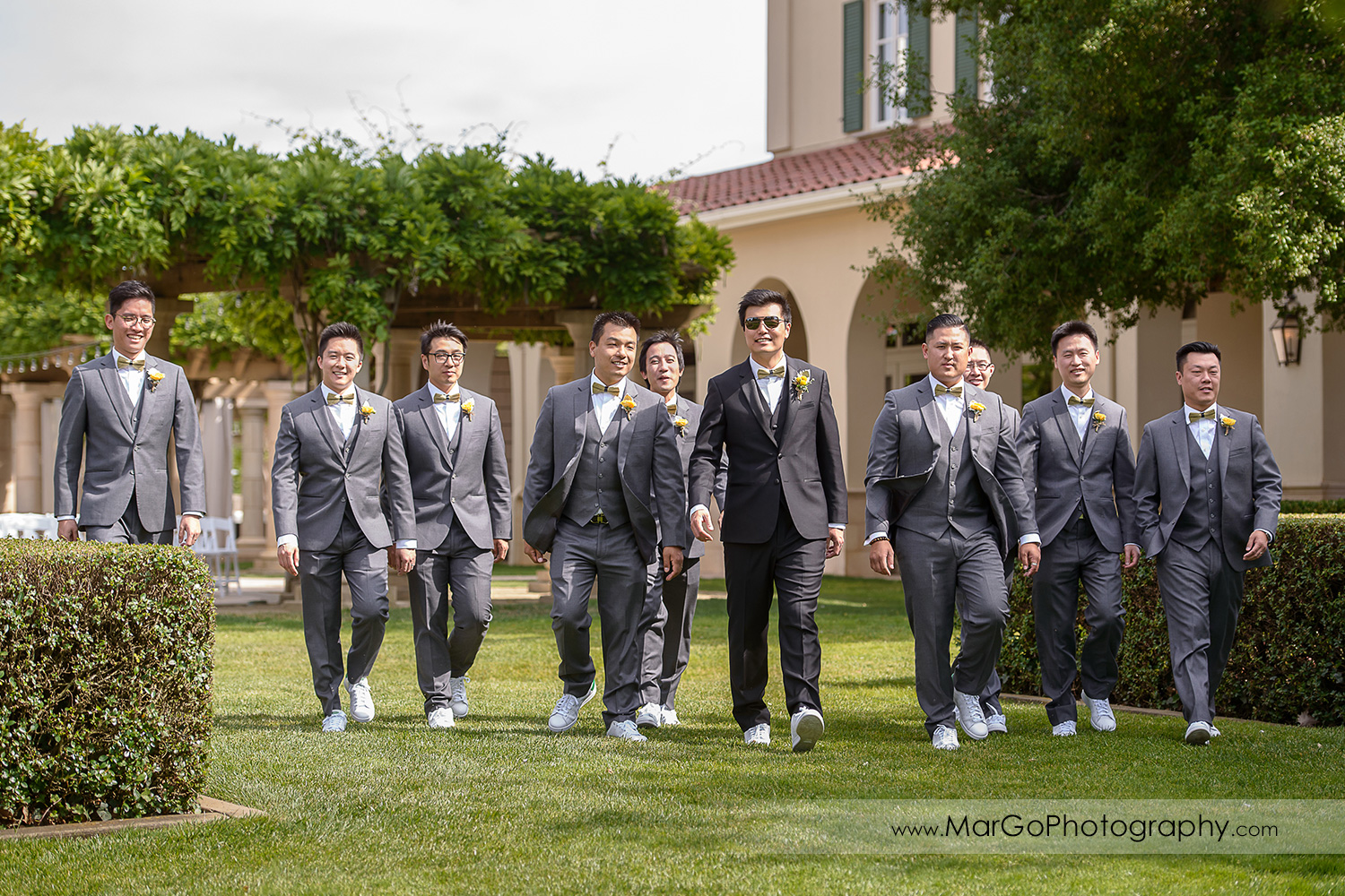 groom and groomsmen walking at the Club at Ruby Hill in Pleasanton