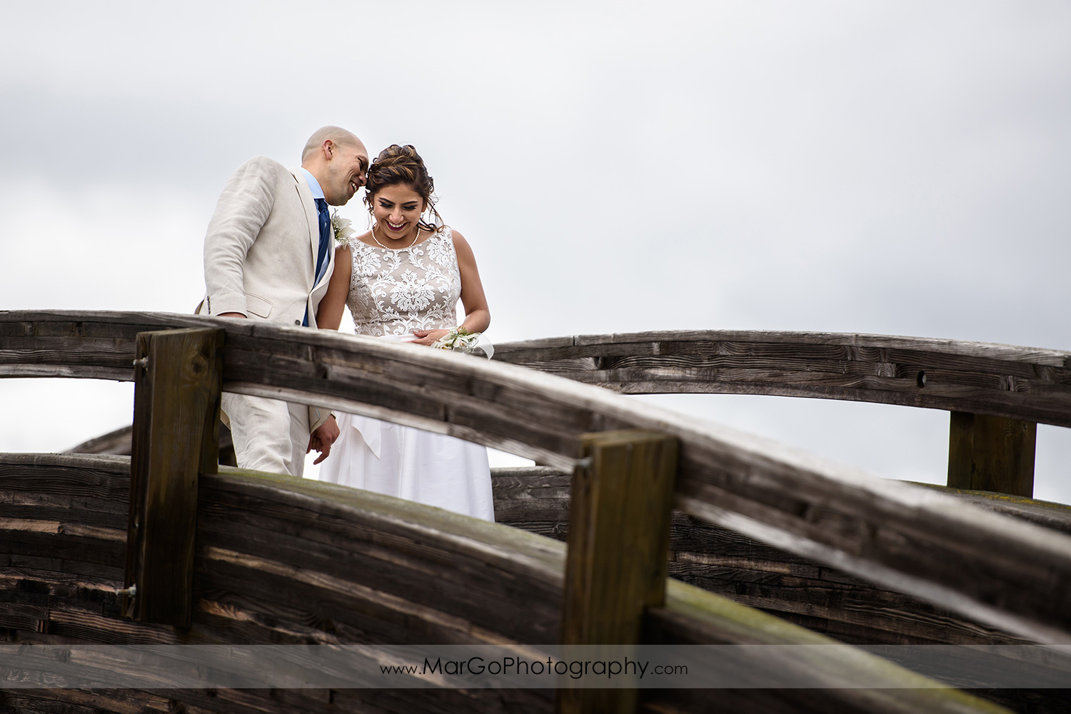 bride and groom together on the bridge at Martinez Regional Shoreline