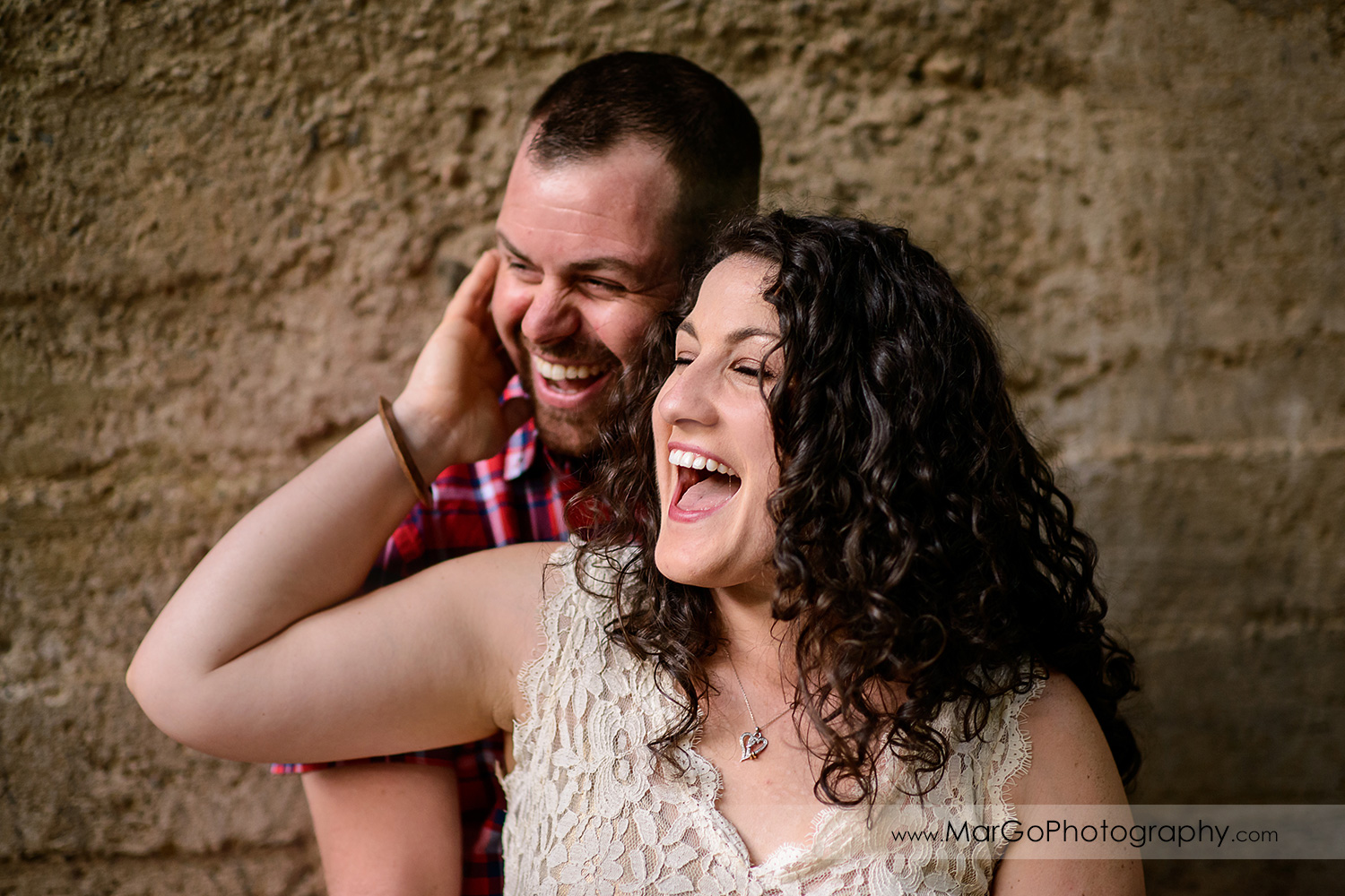 engaged couple laughing at Saratoga Springs
