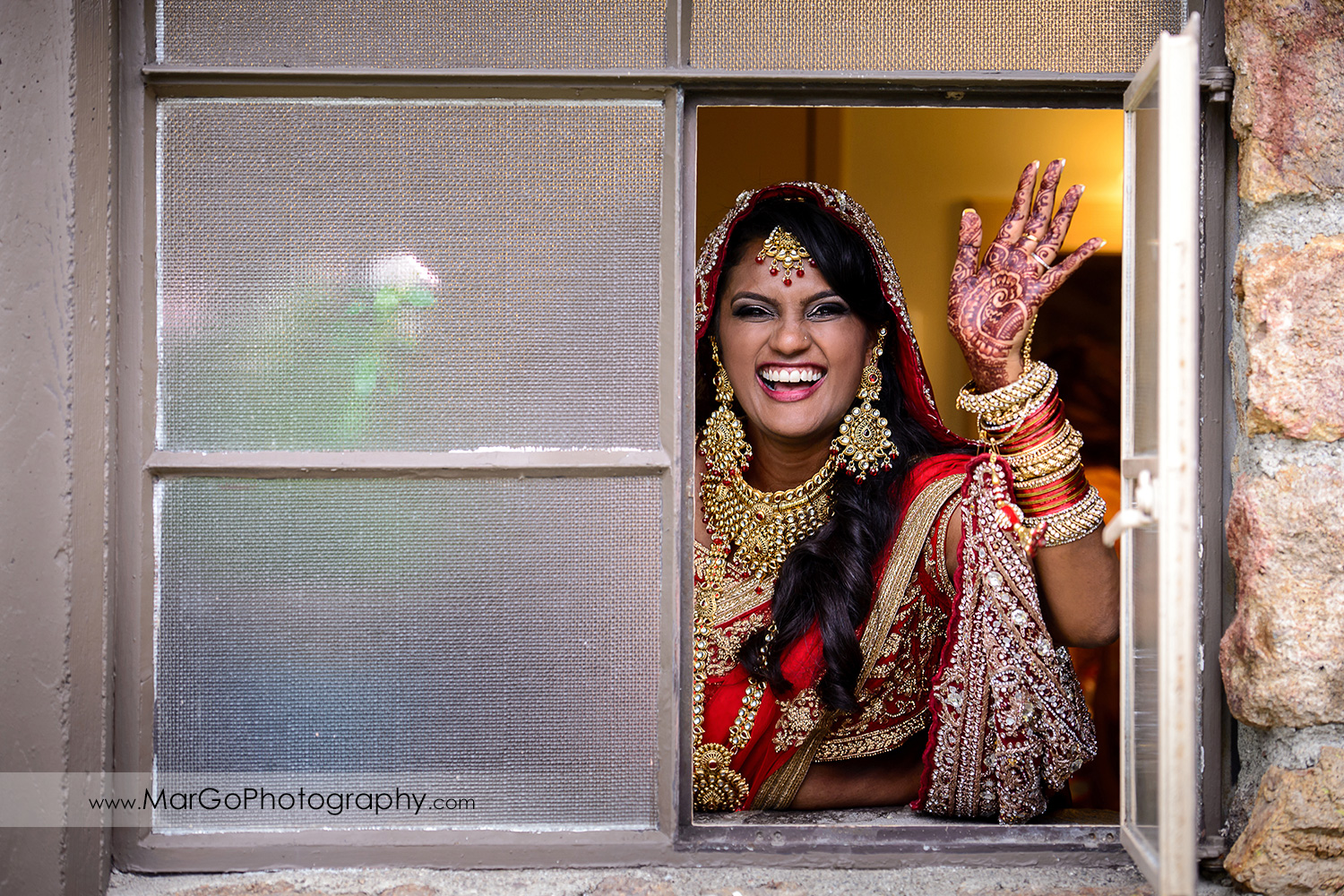 bride in the window in red indian dress at Brazilian Room - Tilden Regional Park, Berkeley