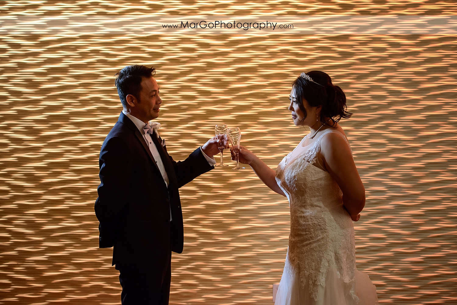 bride and groom's toast at Hilton San Francisco Airport Bayfront in Burlingame