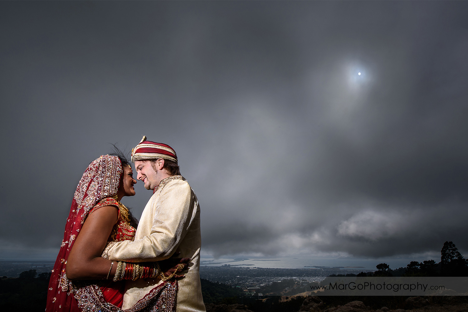 bride and groom with a dark sky before Indian wedding at Tilden Regional Park, Berkeley