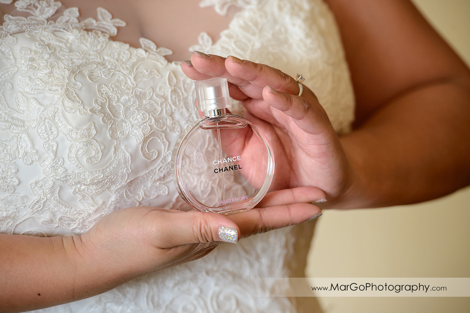 bride showing chanel bottle at Hilton San Francisco Airport Bayfront in Burlingame