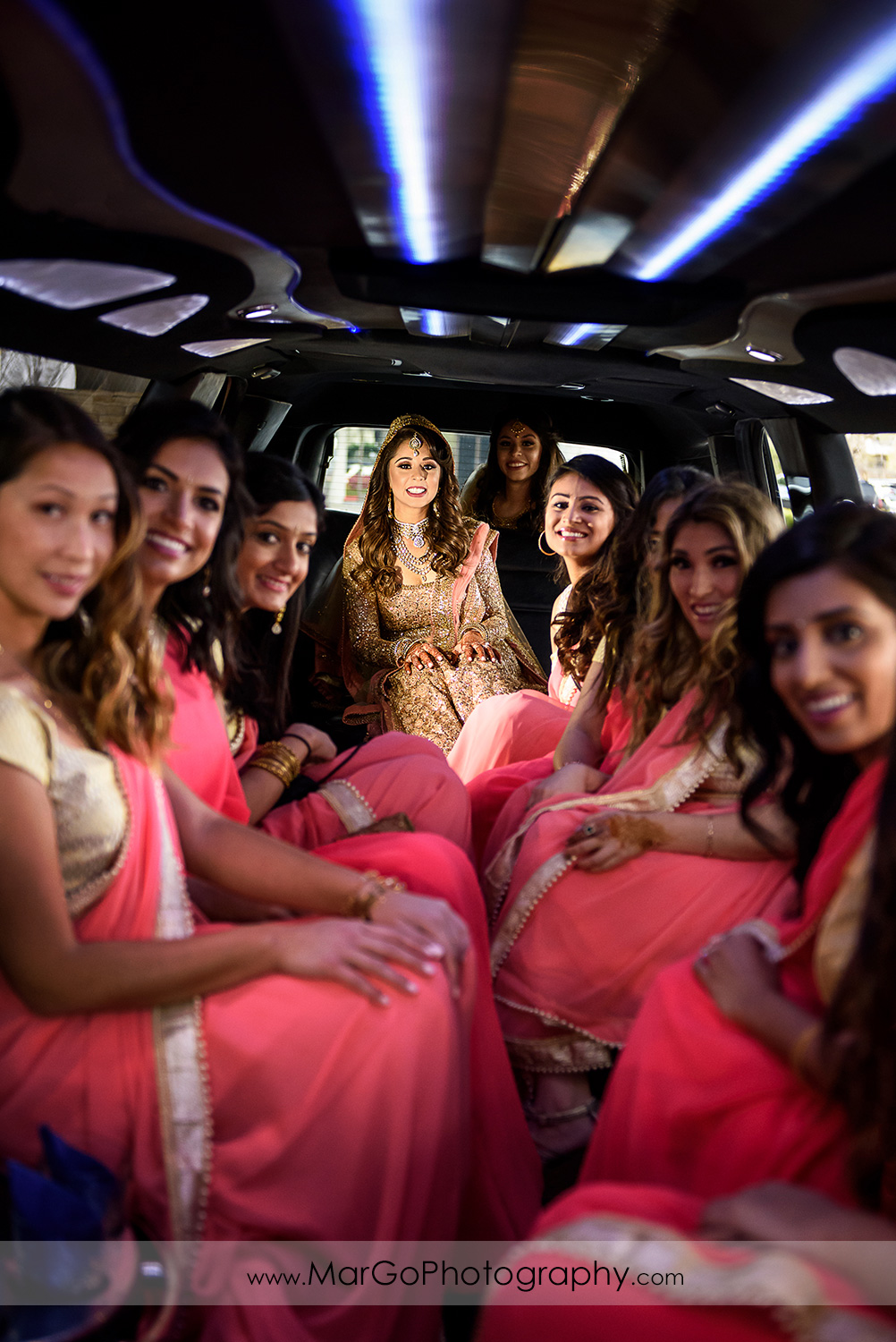 indian bride and bridesmaids in the limousine