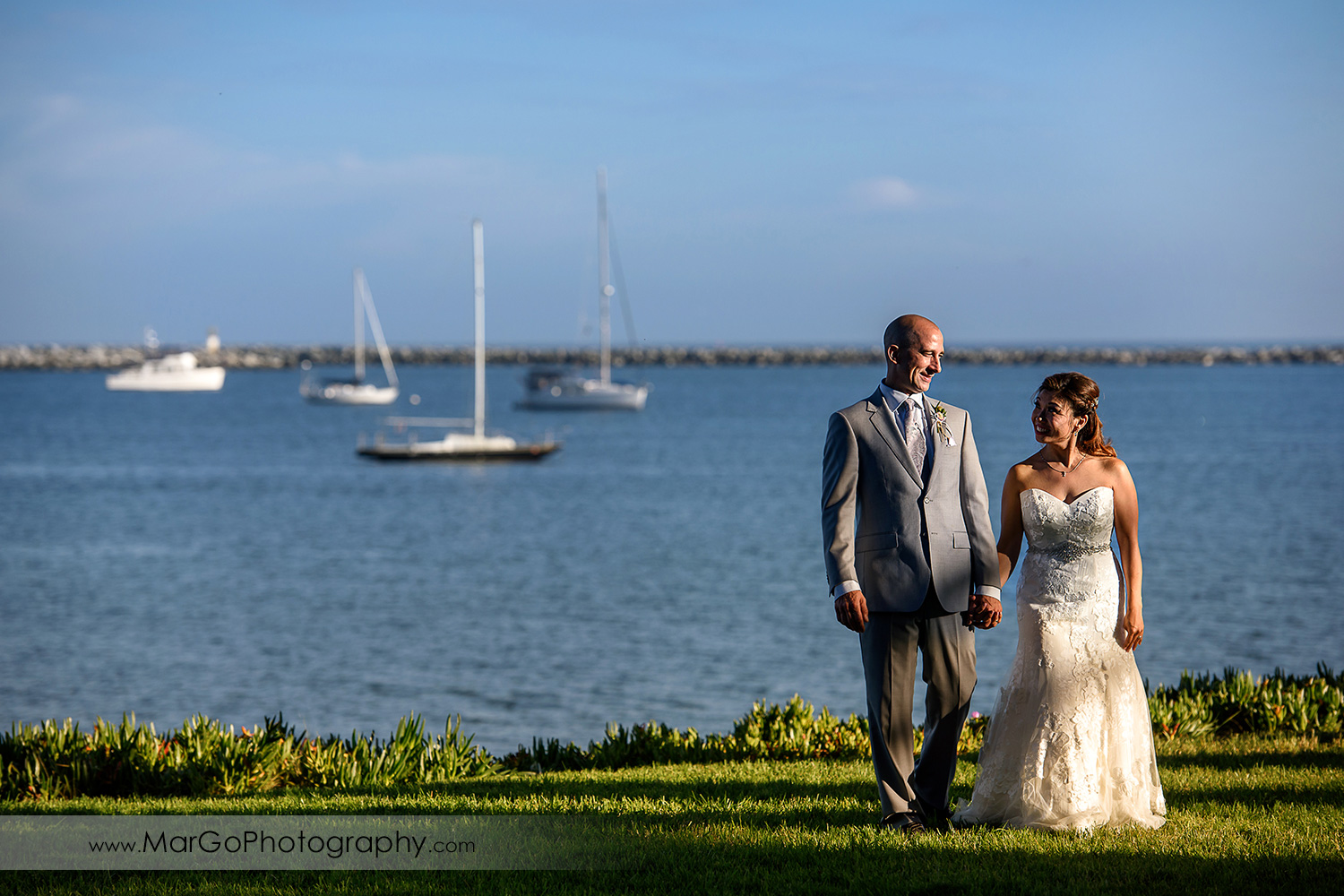 bride and groom with the view of Half Moon Bay at Mavericks Event Center