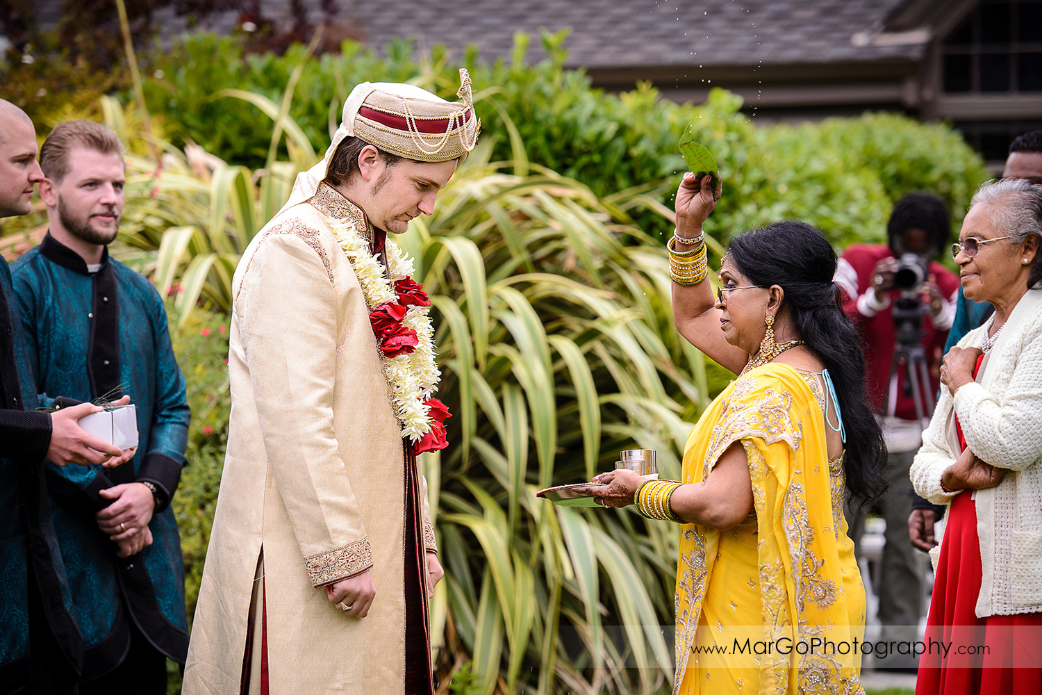bride's mom welcoming the groom during the baraat at Brazilian Room - Tilden Regional Park, Berkeley