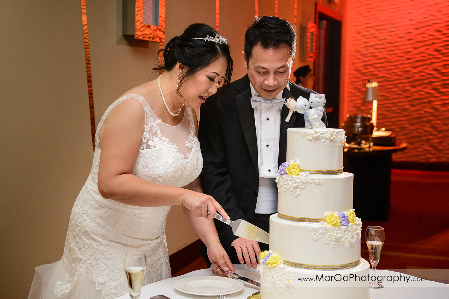wedding cake cutting at Hilton San Francisco Airport Bayfront in Burlingame