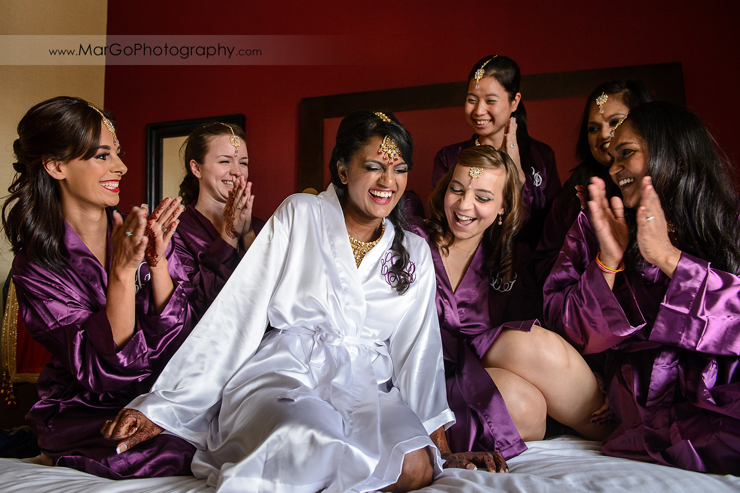 indian bride with bridesmaids in robes laughing at Hotel Shattuck Plaza in Berkeley