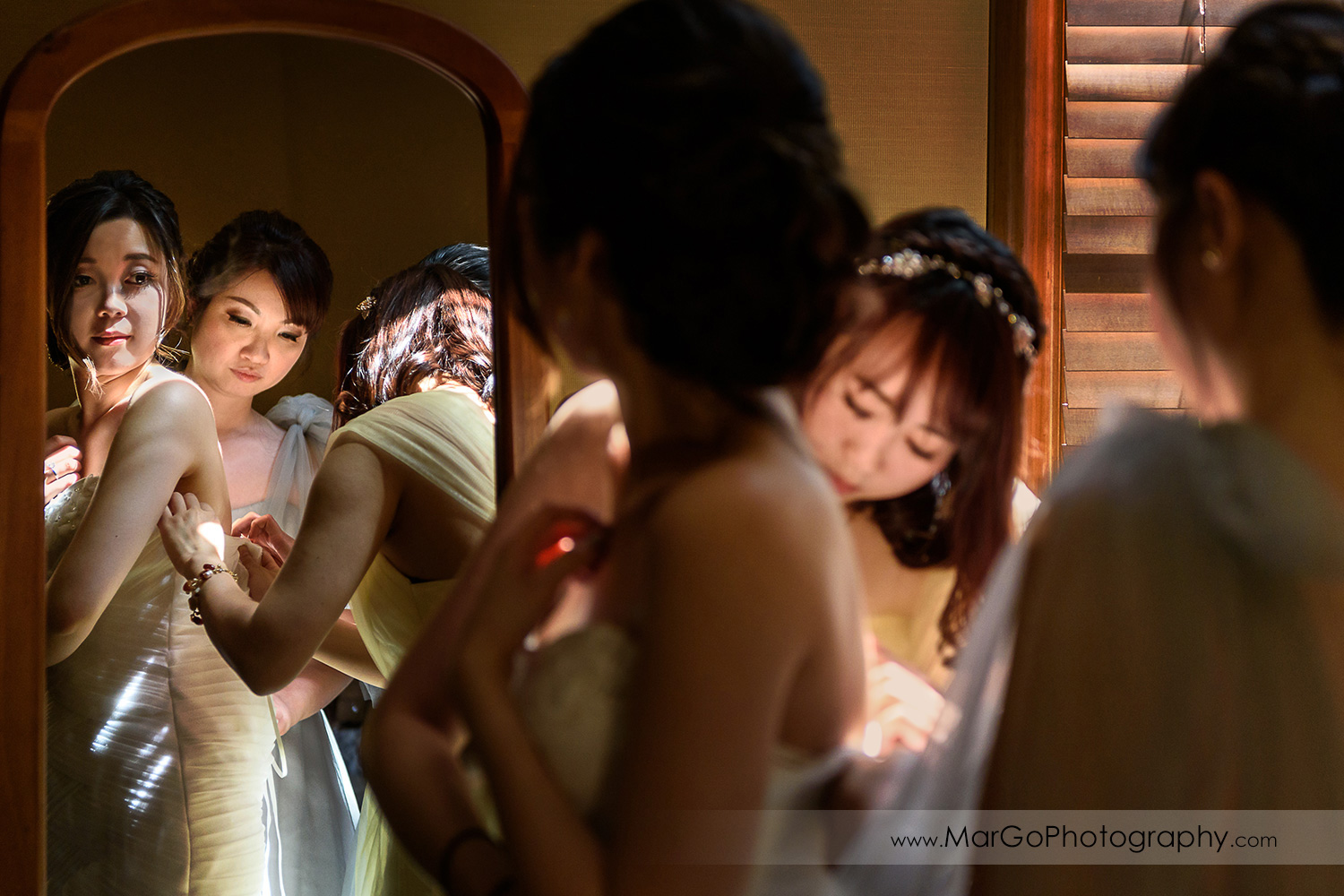 bride getting ready in front of the mirror at the Club at Ruby Hill in Pleasanton
