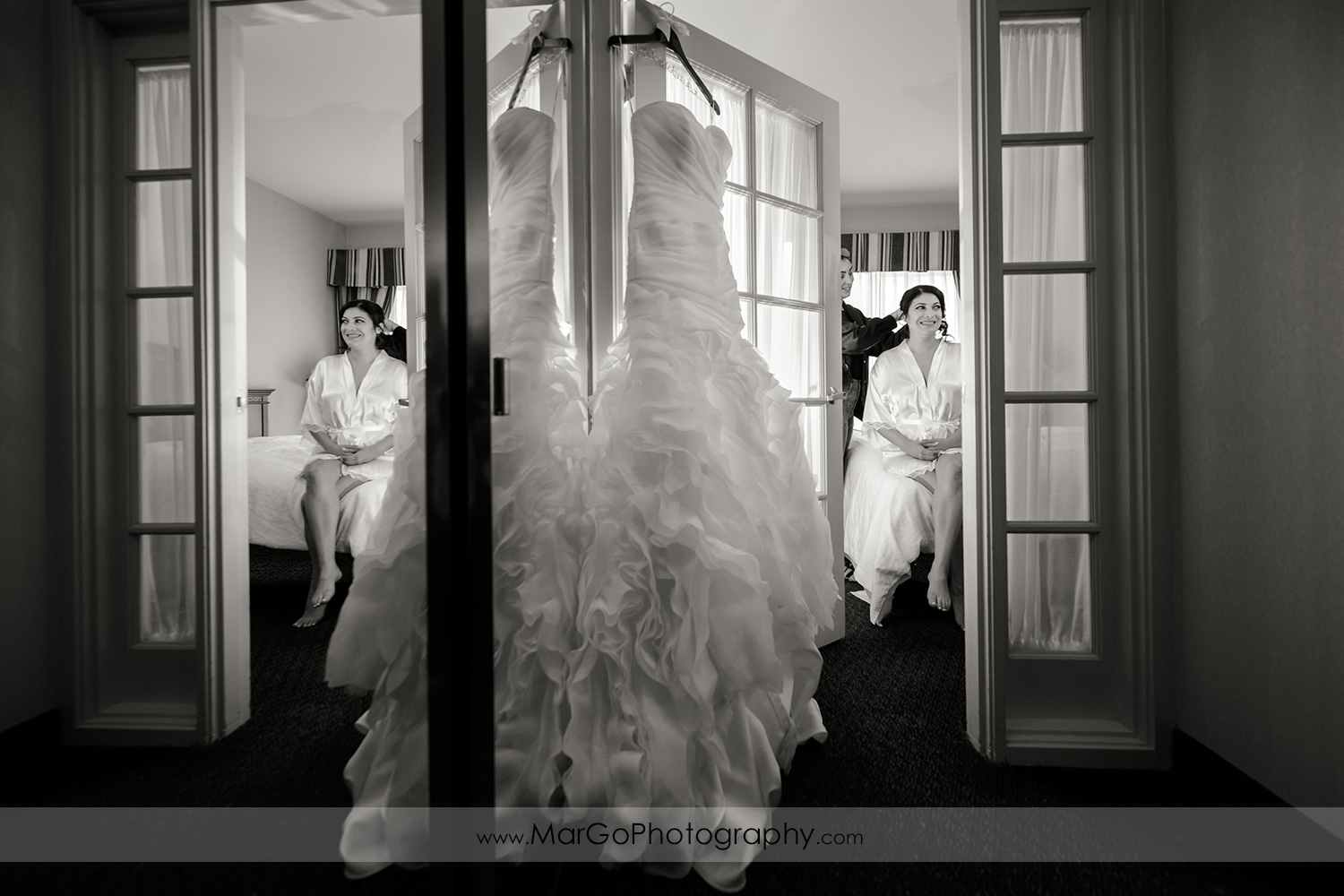 wedding dress with bride getting ready in the background at Hilton Garden Inn Livermore
