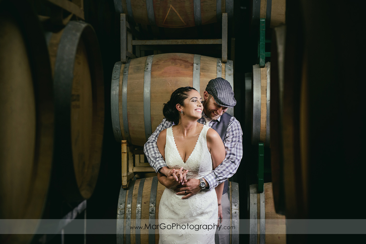 bride & groom in barrel room at Picchetti Winery in Cupertino