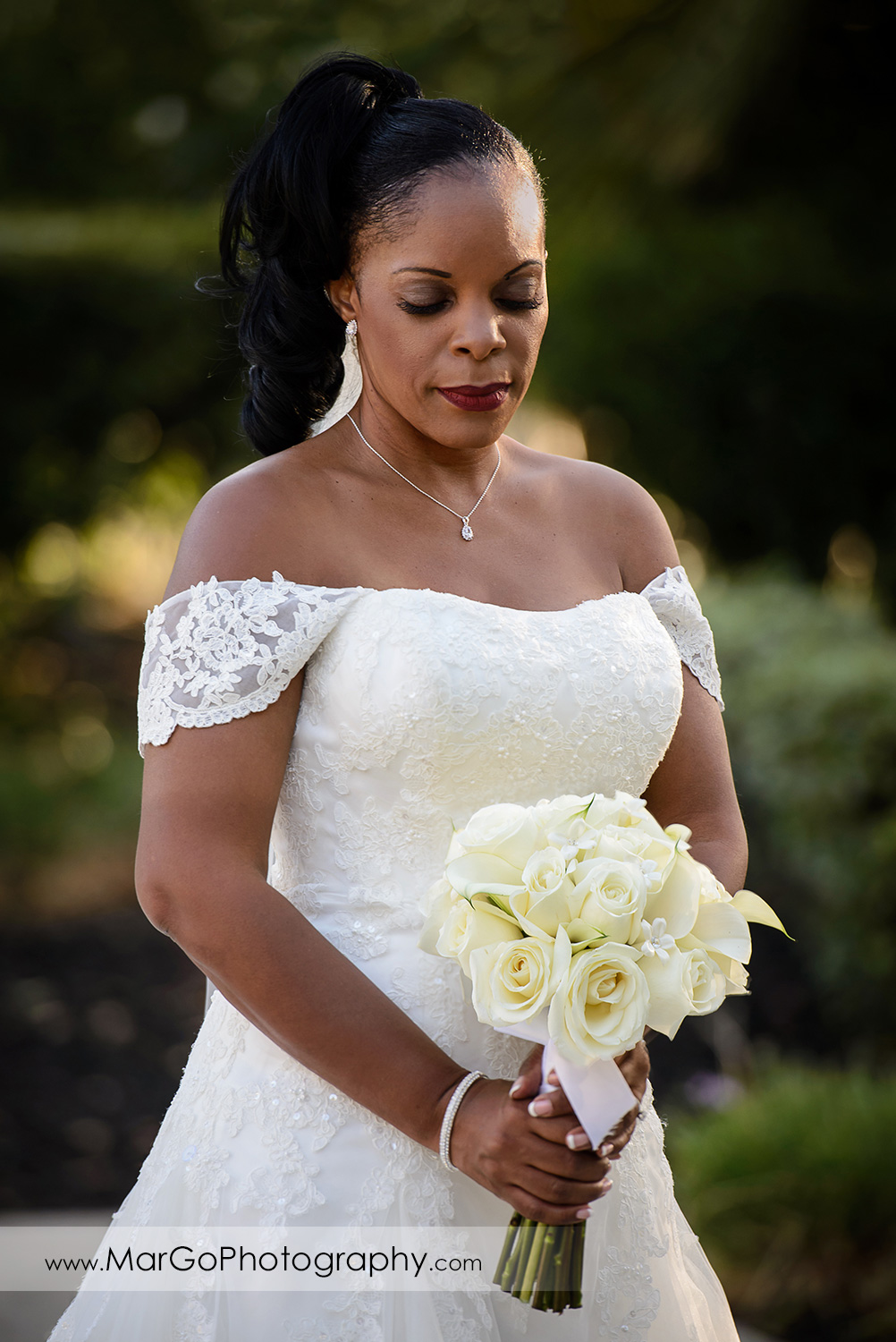 bride looking at the bouquet at Wedgewood Wedding & Banquet Center in Brentwood