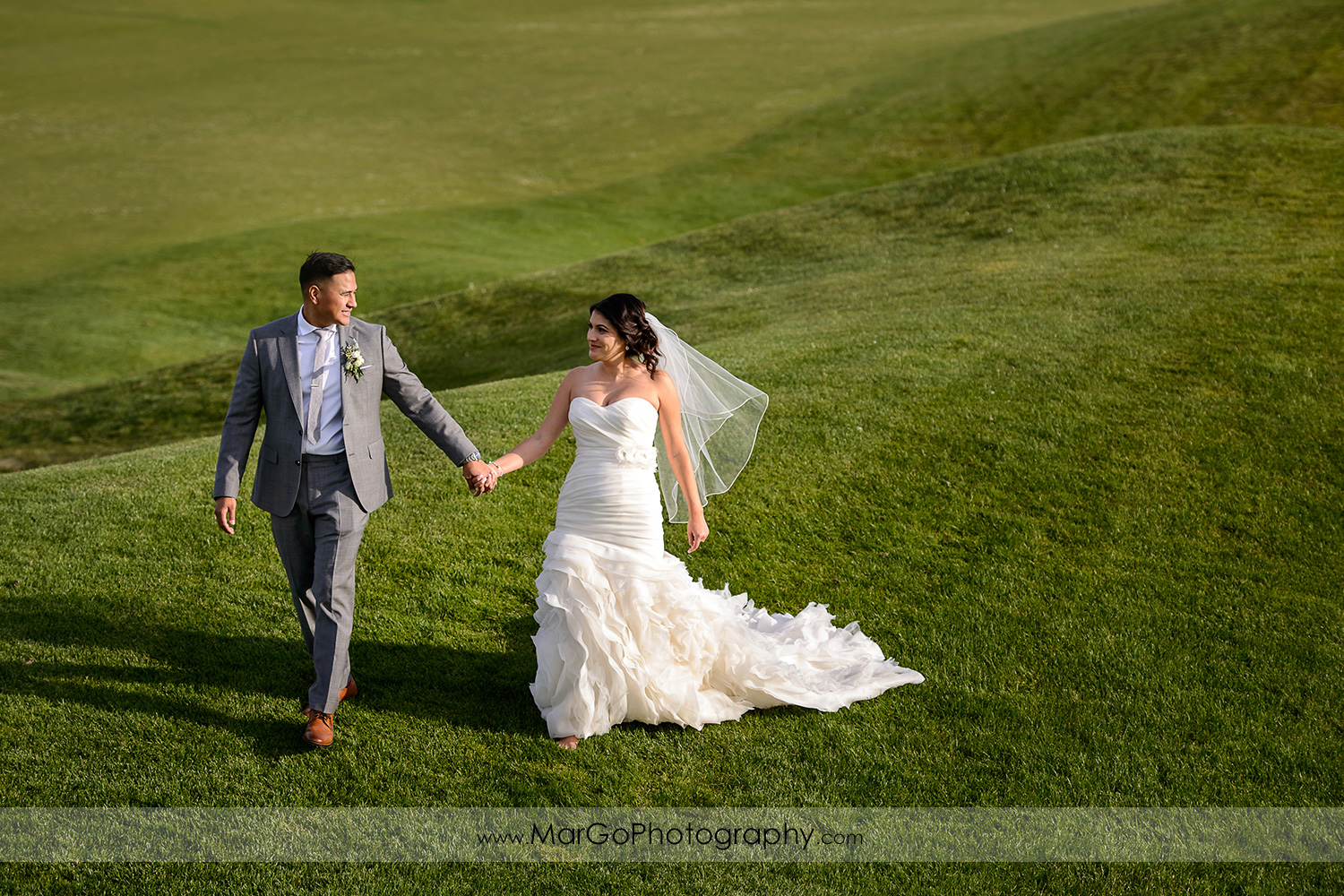 bride and groom walking at Poppy Ridge Golf Course in Livermore