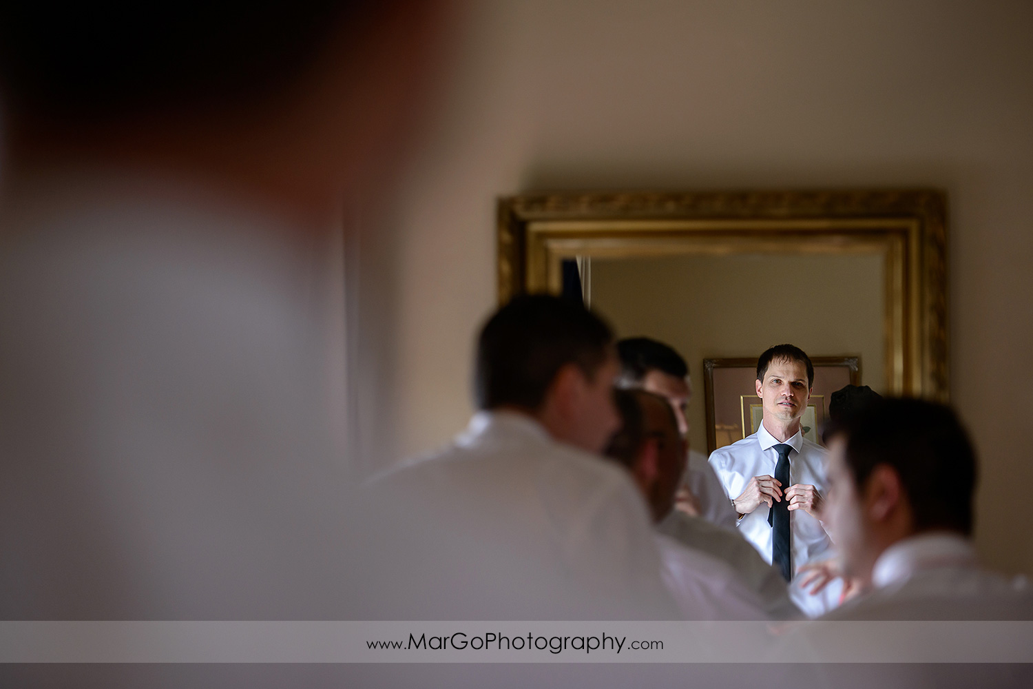 groom and groomsmen getting ready in front of the mirror at Berkeley City Club