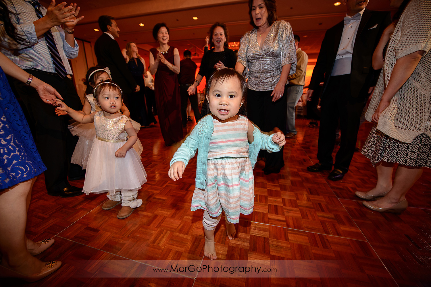 kids on wedding dance floor at Hilton San Francisco Airport Bayfront in Burlingame