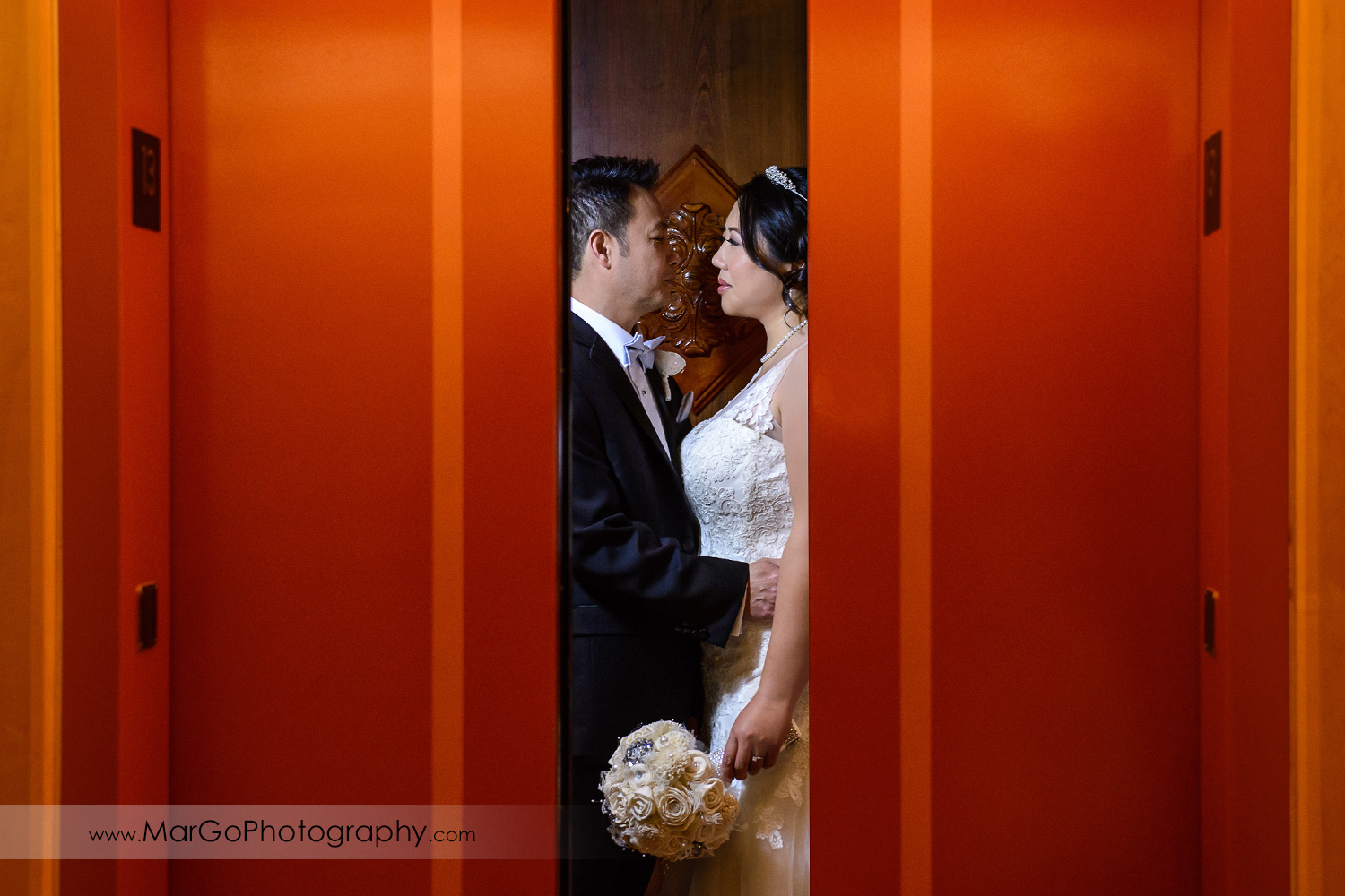 bride and groom in the elevator Hilton San Francisco Airport Bayfront in Burlingame