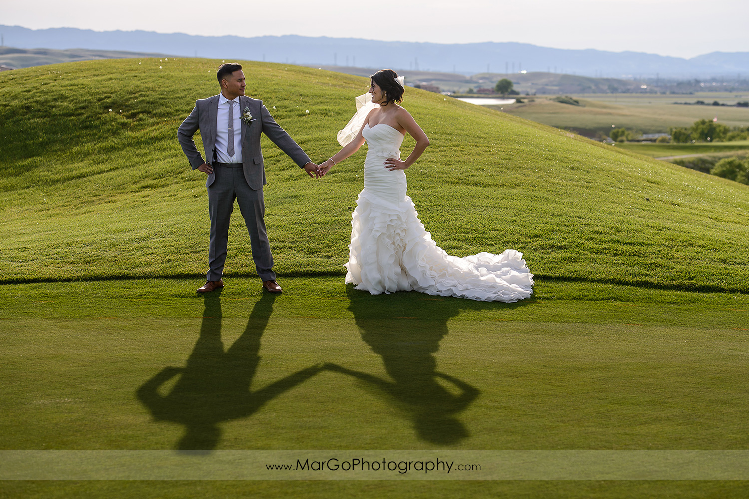shadows of bride and groom at Poppy Ridge Golf Course in Livermore