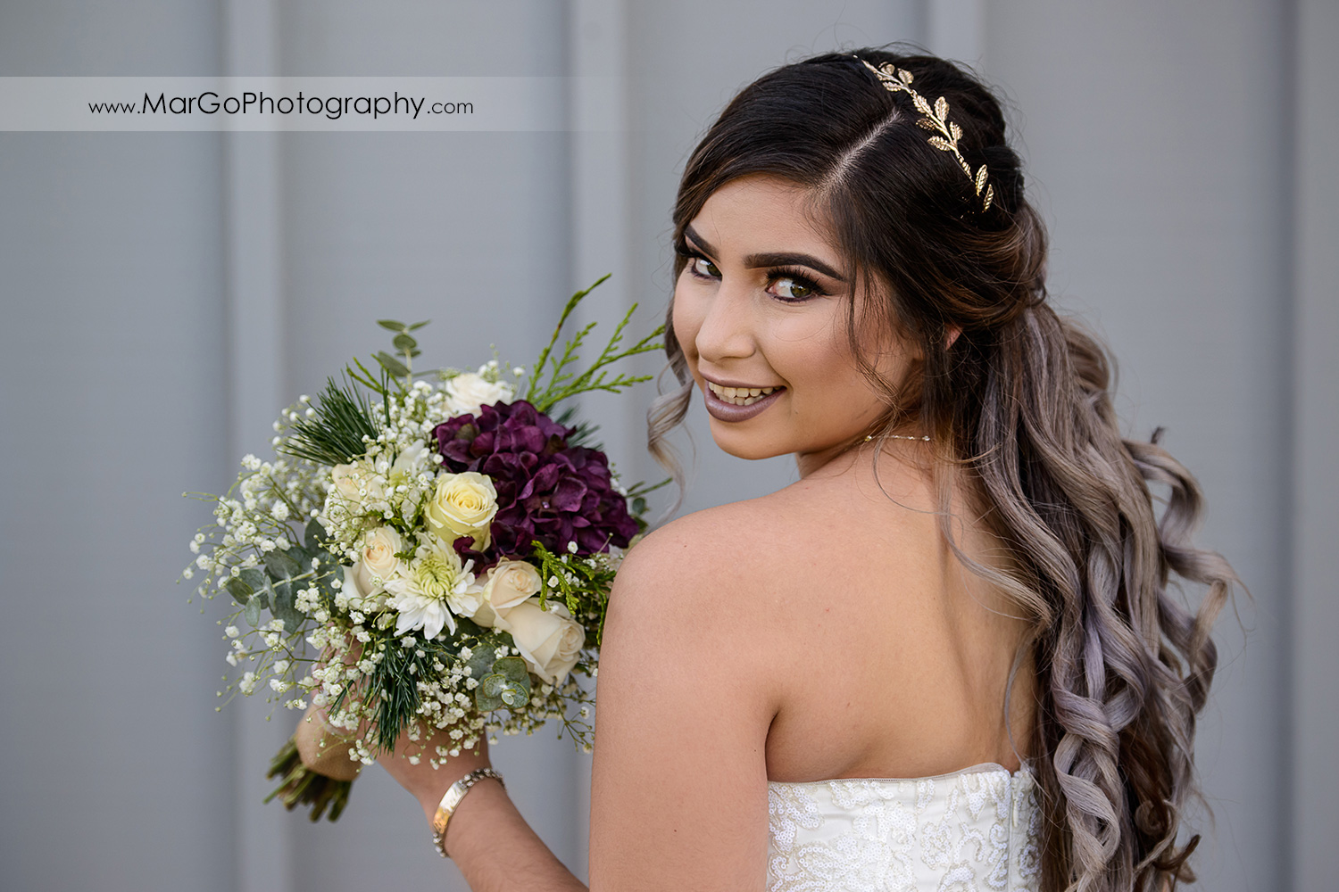 bride posing with her bouquet at Pleasant Hill City Hall