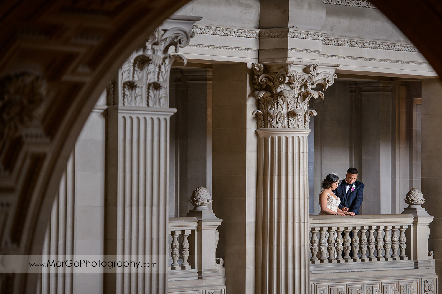 bride and groom under the arch at San Francisco City Hall
