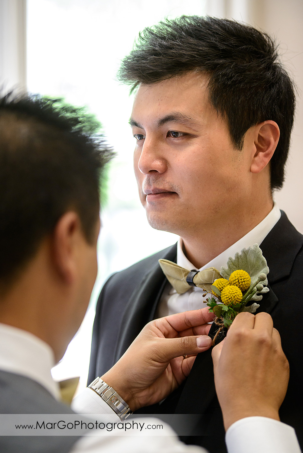 groom's yellow boutonniere at the Club at Ruby Hill in Pleasanton