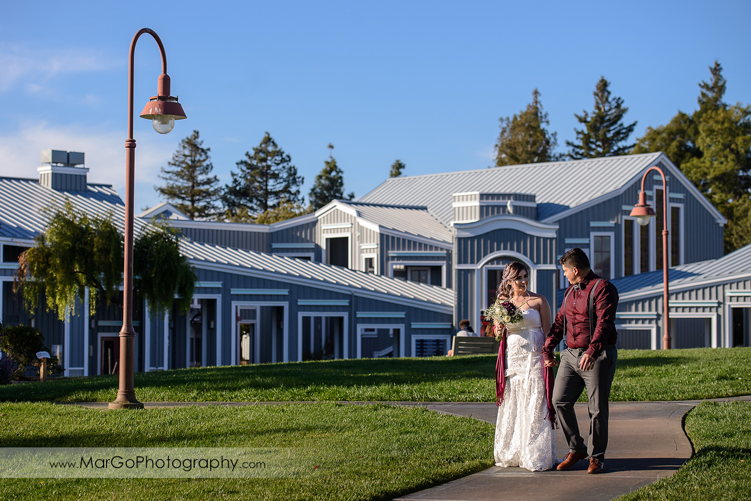 bride and groom walking at Pleasant Hill City Hall