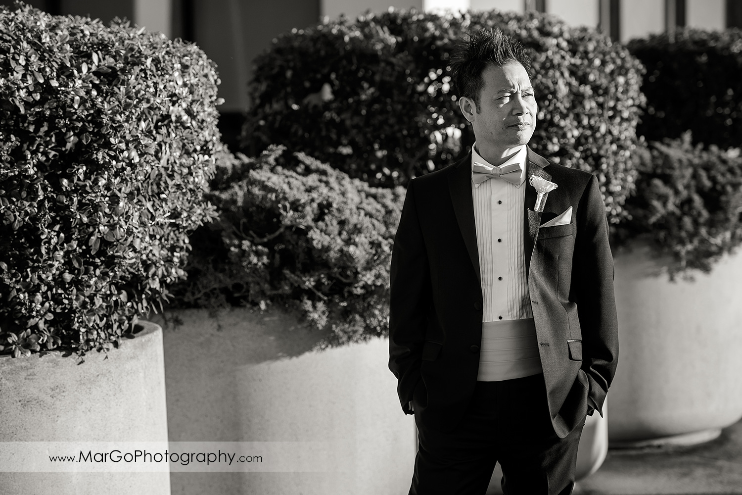 black and white portrait of the groom at Hilton San Francisco Airport Bayfront in Burlingame